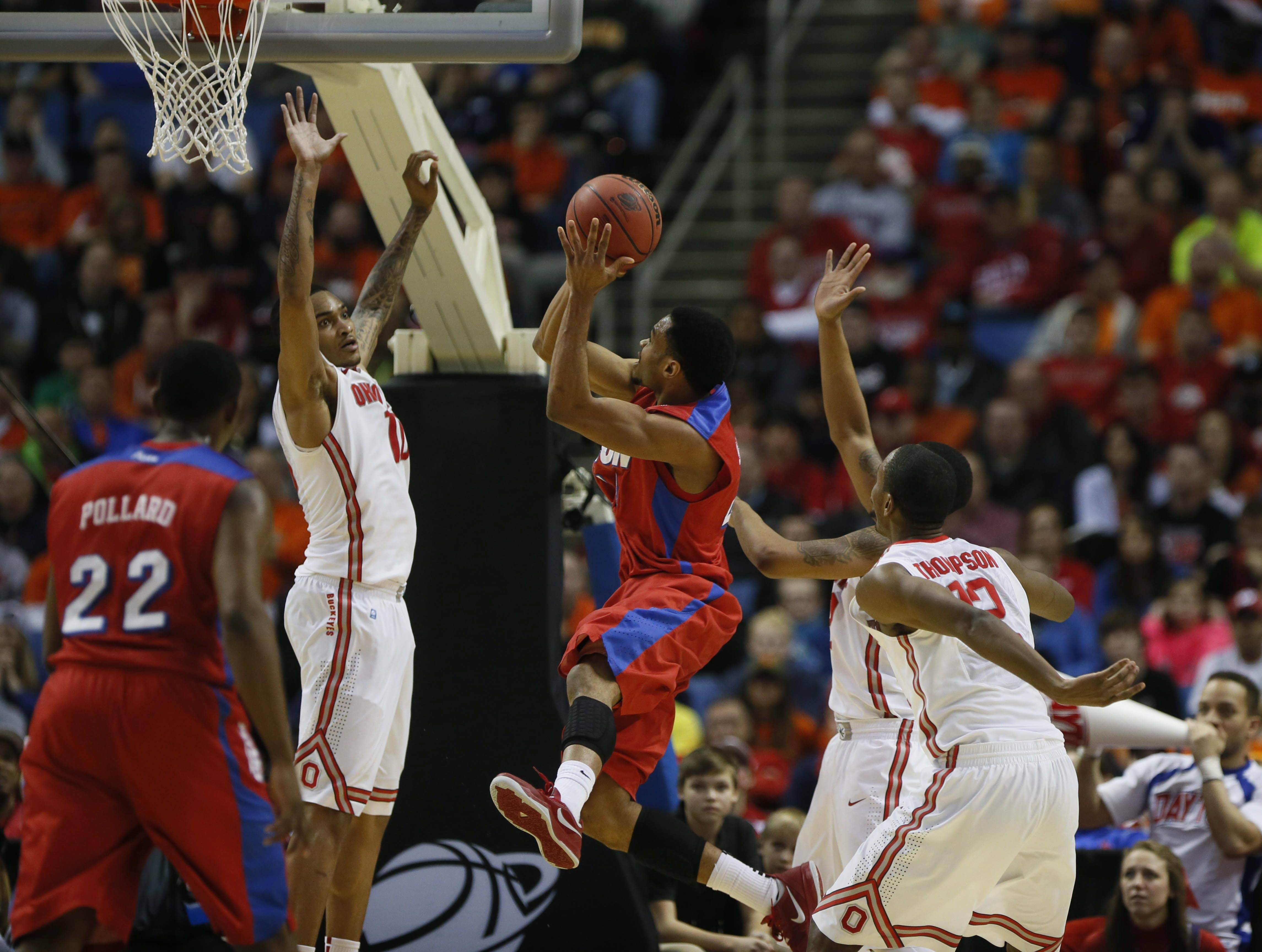Dayton's Vee Sanford, center, puts up a shot against Ohio State during a second-round game of the NCAA college basketball tournament in Buffalo, N.Y., Thursday, March 20, 2014. (AP Photo/The Buffalo News, Robert Kirkham) TV OUT; MAGS OUT; MANDATORY CREDIT; BATAVIA DAILY NEWS OUT; DUNKIRK OBSERVER OUT; JAMESTOWN POST-JOURNAL OUT; LOCKPORT UNION-SUN JOURNAL OUT; NIAGARA GAZETTE OUT; OLEAN TIMES-HERALD OUT; SALAMANCA PRESS OUT; TONAWANDA NEWS OUT