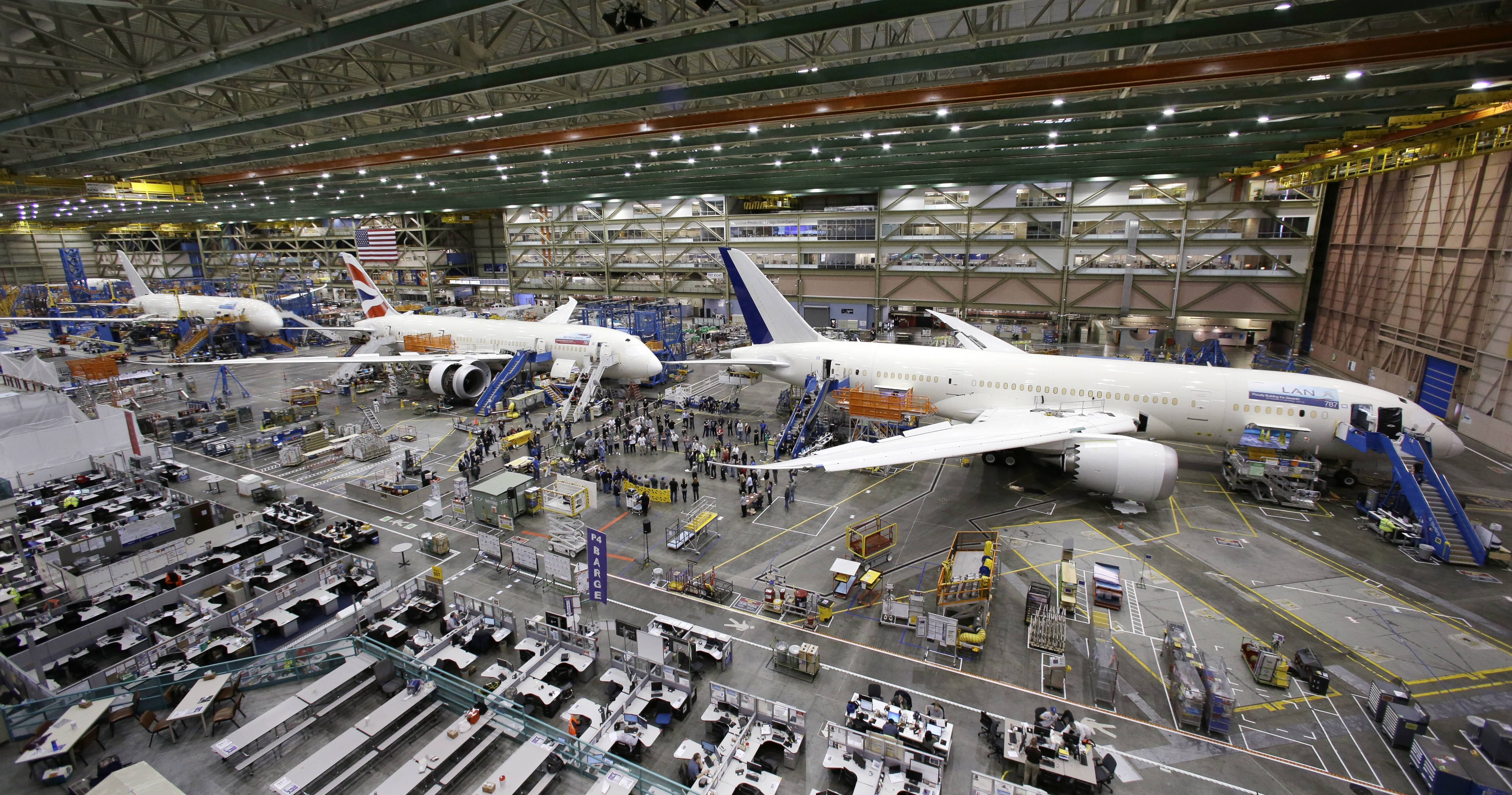 A line of Boeing 787 jets on the floor nearing completion at the company's production plant in Everett, Wash.