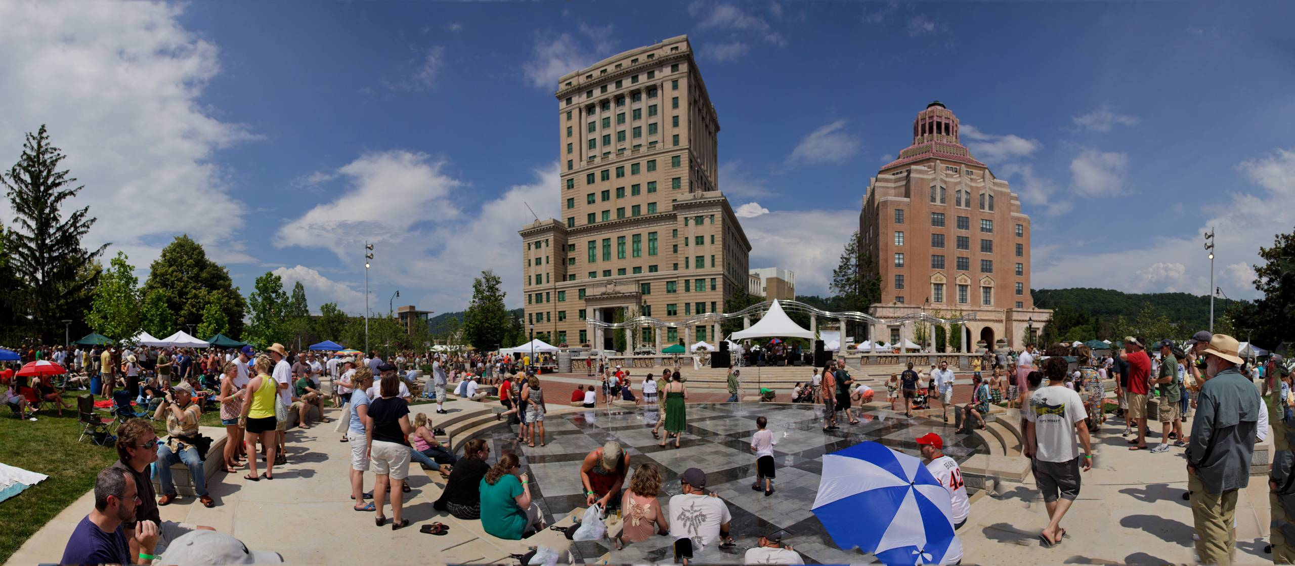 Especially on summer nights, people gather at Pack Square Park in Asheville, N.C., near the county courthouse, left, and City Hall on the right. The park is a popular place to stroll or hang out, with live music events on some summer Saturdays and an interactive water fountain.