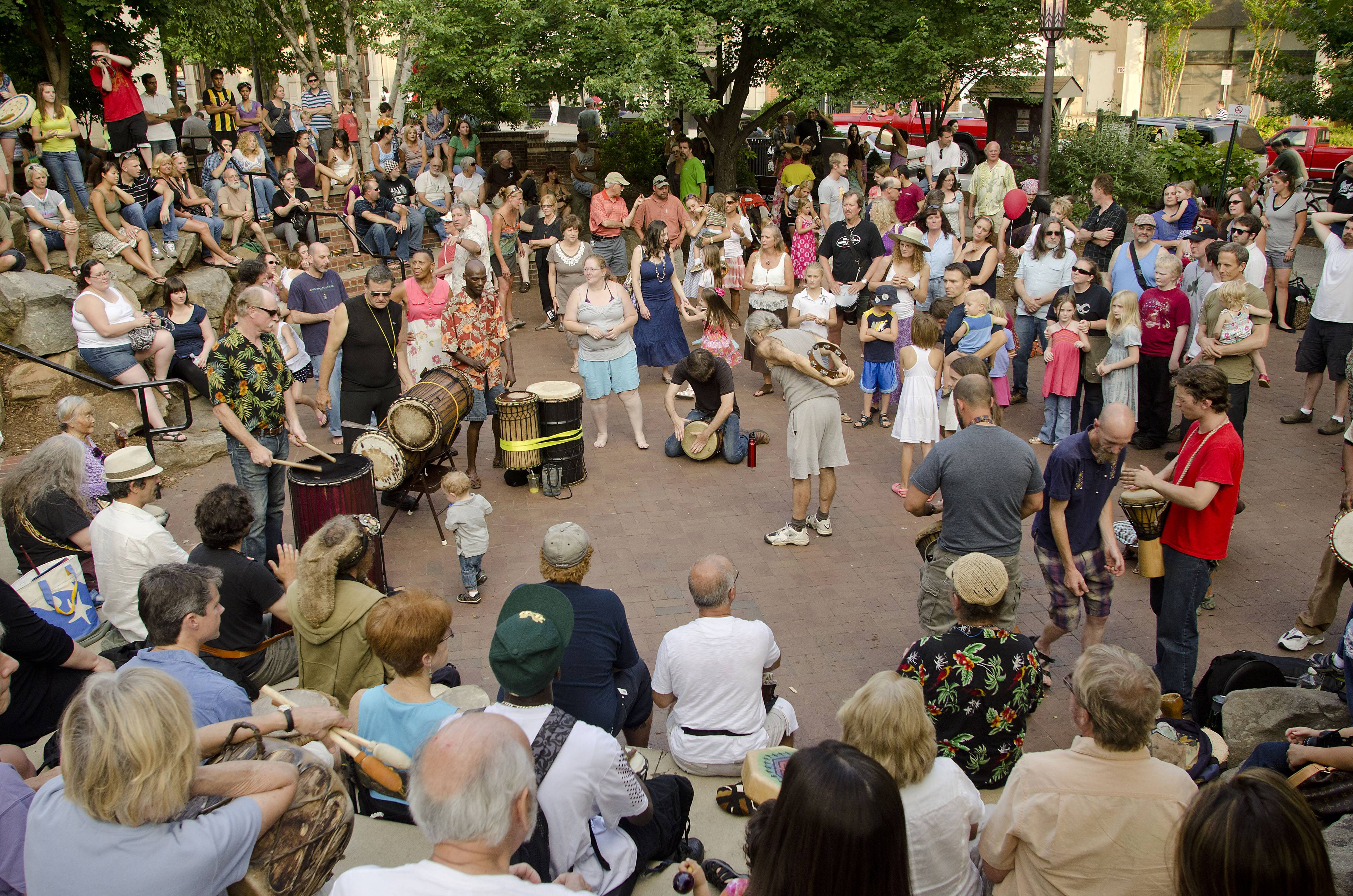 Visitors to Pritchard Park in Asheville, N.C., take in a drum circle. This gem of a city tucked in the Blue Ridge foothills of western North Carolina attracts artists, musicians, foodies and outdoor enthusiasts.