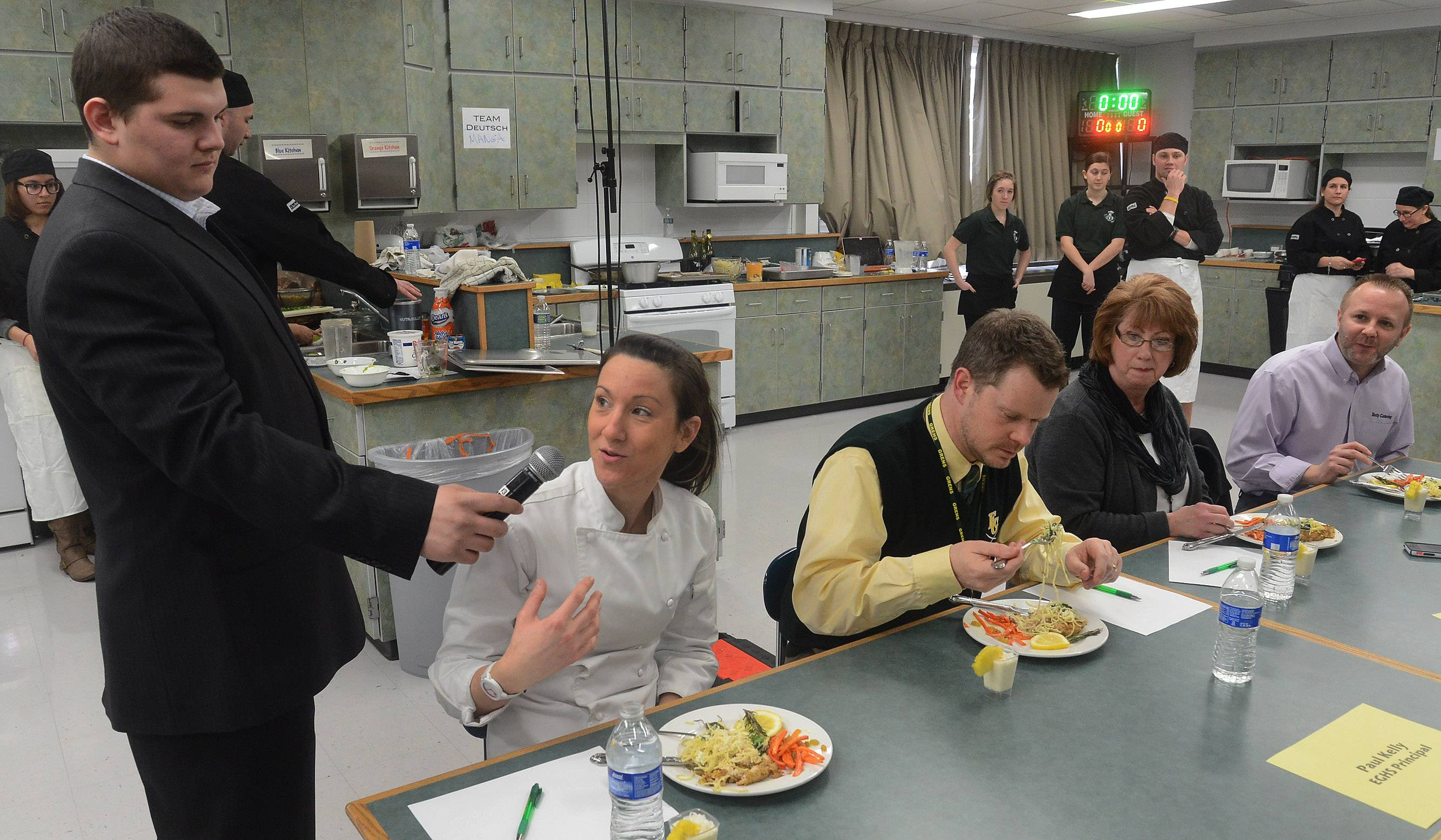 Executive Chef Angela Delmark of Seasons 52 in Schaumburg gives her opinion of one of the dishes while judging Elk Grove High School's ProStart vs. Faculty Cook-off.