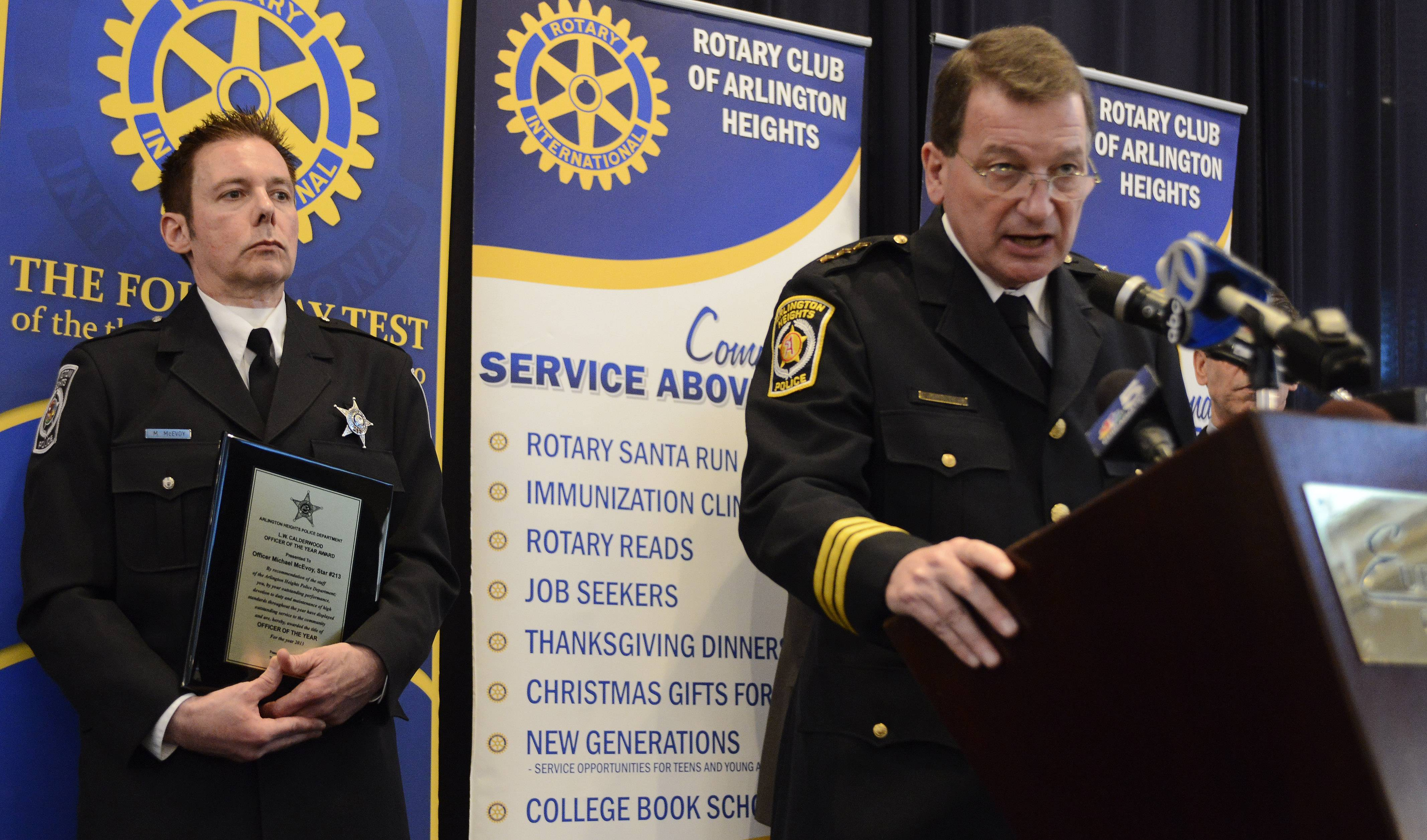 Arlington Heights Chief of Police Gerald Mourning, right, speaks after the presentation of the L.W. Calderwood Officer of the Year award to Michael McEvoy.