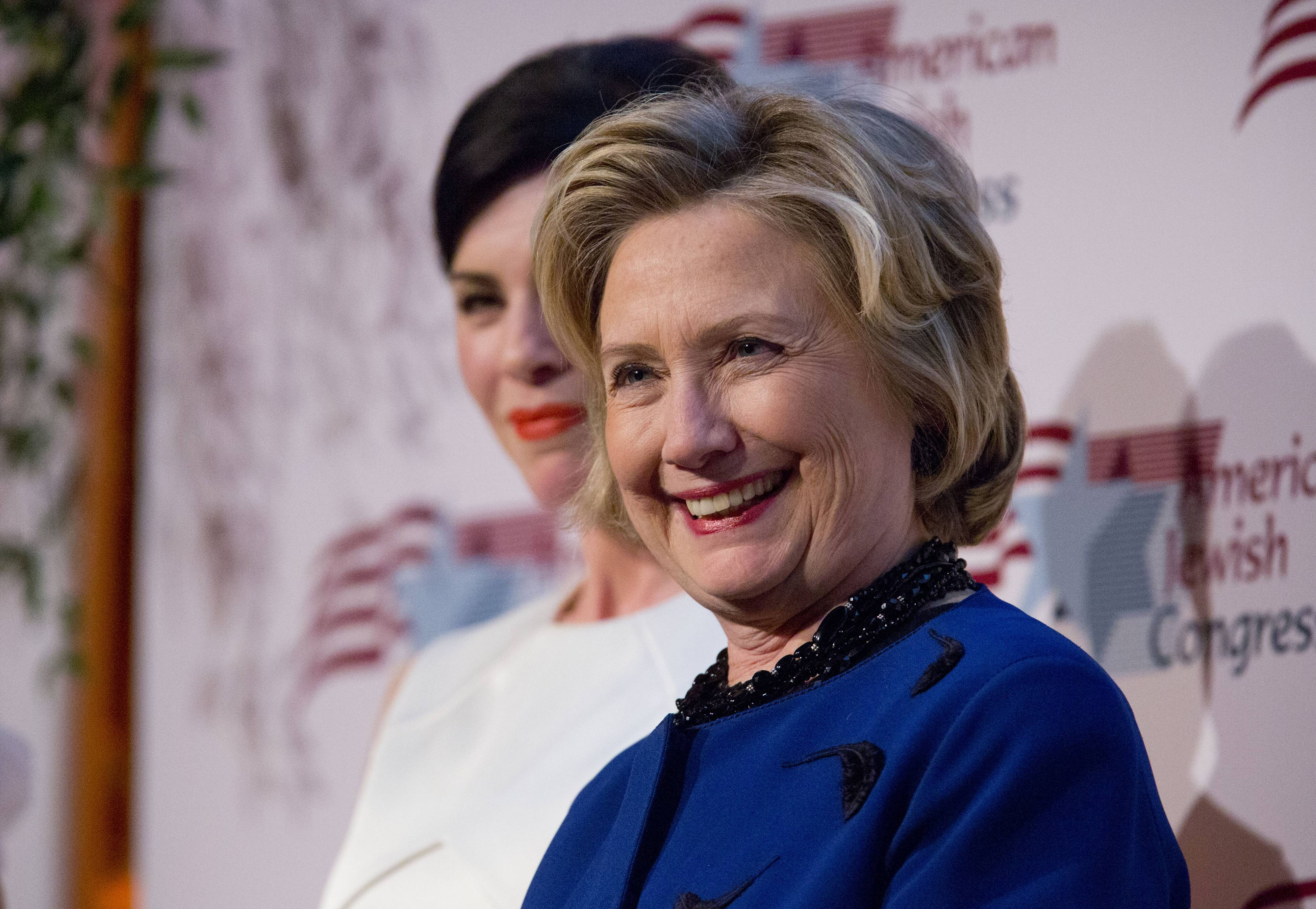 Actress Juliana Margulies, left, and former Secretary of State Hillary Rodham Clinton listen before Clinton receives the American Jewish Congress' lifetime achievement award on Wednesday in New York.