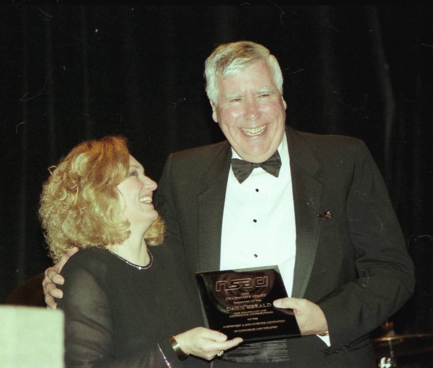 Jim Walsh Sr. accepts the Chairman's Award from Lynne Nicklas-Linowski on behalf of the Daily Herald at the Northwest Suburban Association of Commerce and Industry dinner in 1999. Walsh, who spent four decades in the newspaper industry and retired as a vice president at the Daily Herald, died Thursday. He was 76.