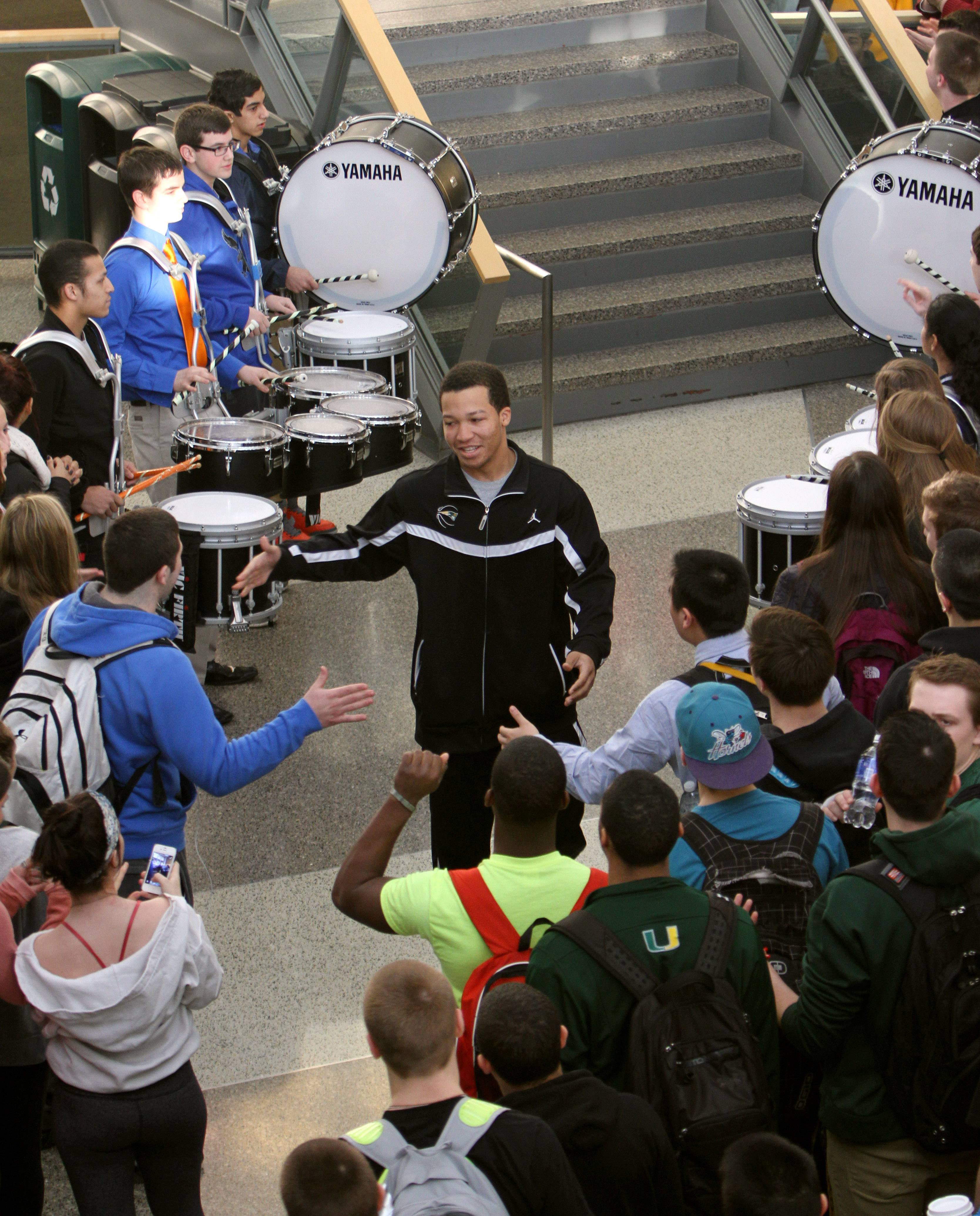 Jalen Brunson high-fives students Thursday as the Stevenson High School boy's basketball team gets a send off to the IHSA Class 4A state championships that start Friday in Peoria. Also honored were the school's debate and scholastic bowl teams, which compete for state championships this weekend.