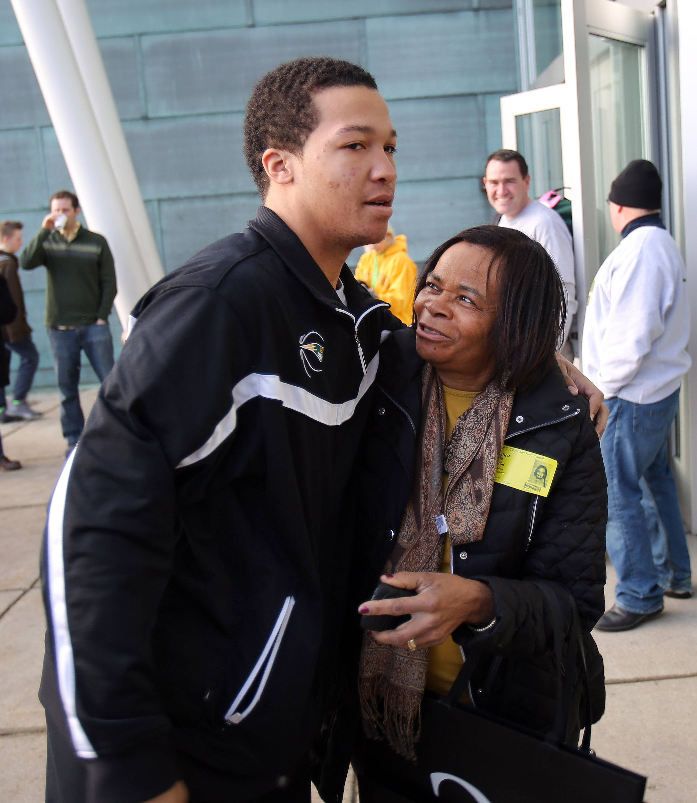 Stevenson High School basketball star Jalen Brunson hugs his grandmother, Judy Davis, during Thursday's send off for the basketball team ahead of the IHSA Class 4A state championships starting Friday in Peoria. Also honored were the school's debate and scholastic bowl teams, which compete for state championships this weekend.