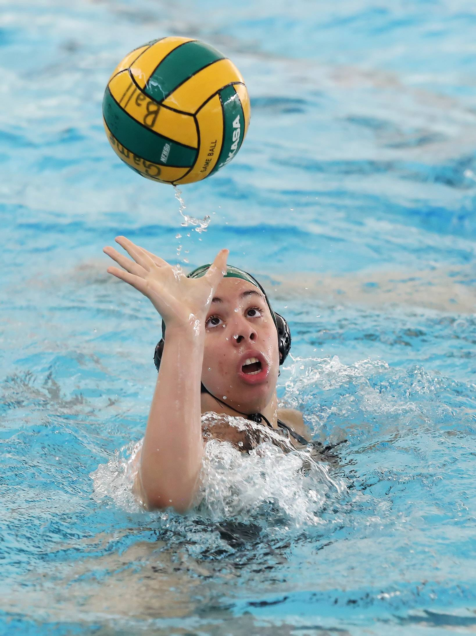 Stevenson's Ashley Oliver pops the ball up in the air against Oak Park on Thursday in Lincolnshire.