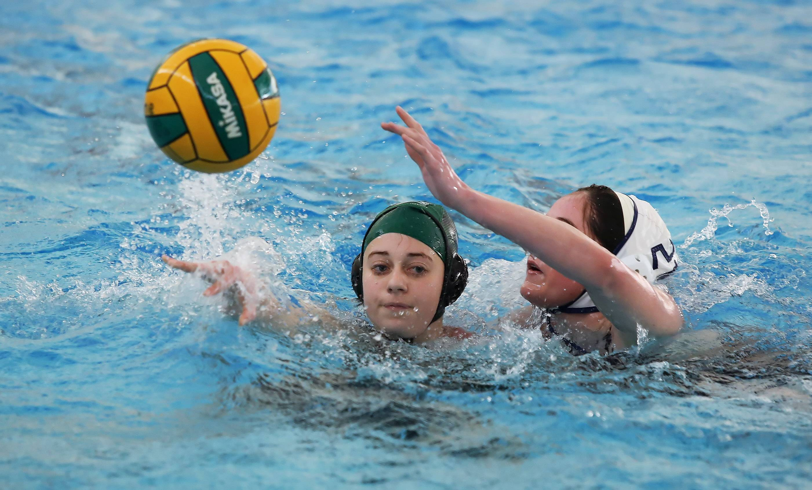 Stevenson player Melissa Gartenberg passes the ball before being taking contact from Oak Park's Jilly Cronin on Thursday.