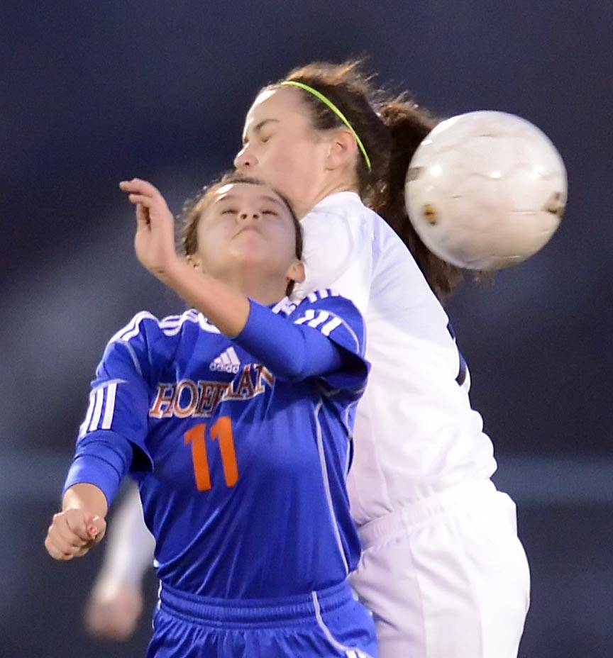 South Elgin's Missy Greco and Hoffman Estates' Alejandra Alonso compete for a header Thursday at Millennium Field in Streamwood.