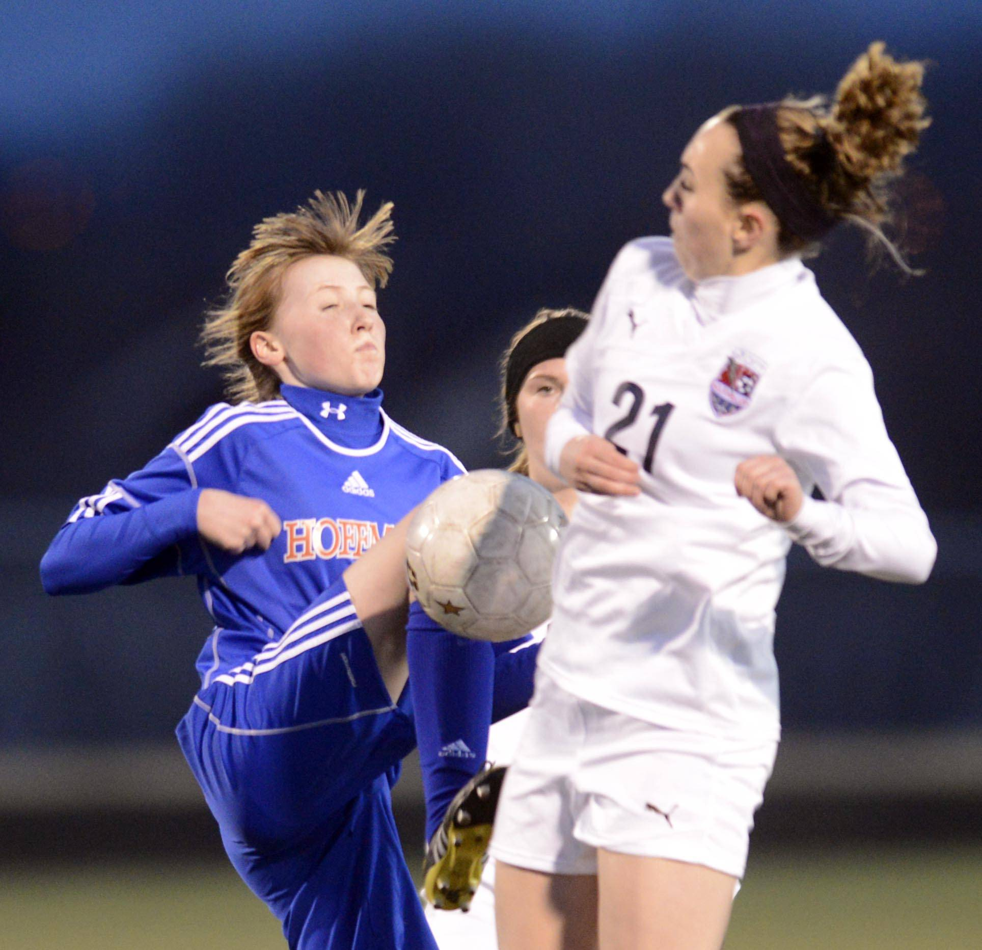 South Elgin's Julie Greco and Hoffman Estates' Erin Hanson compete for the ball Thursday at Millennium Field in Streamwood.