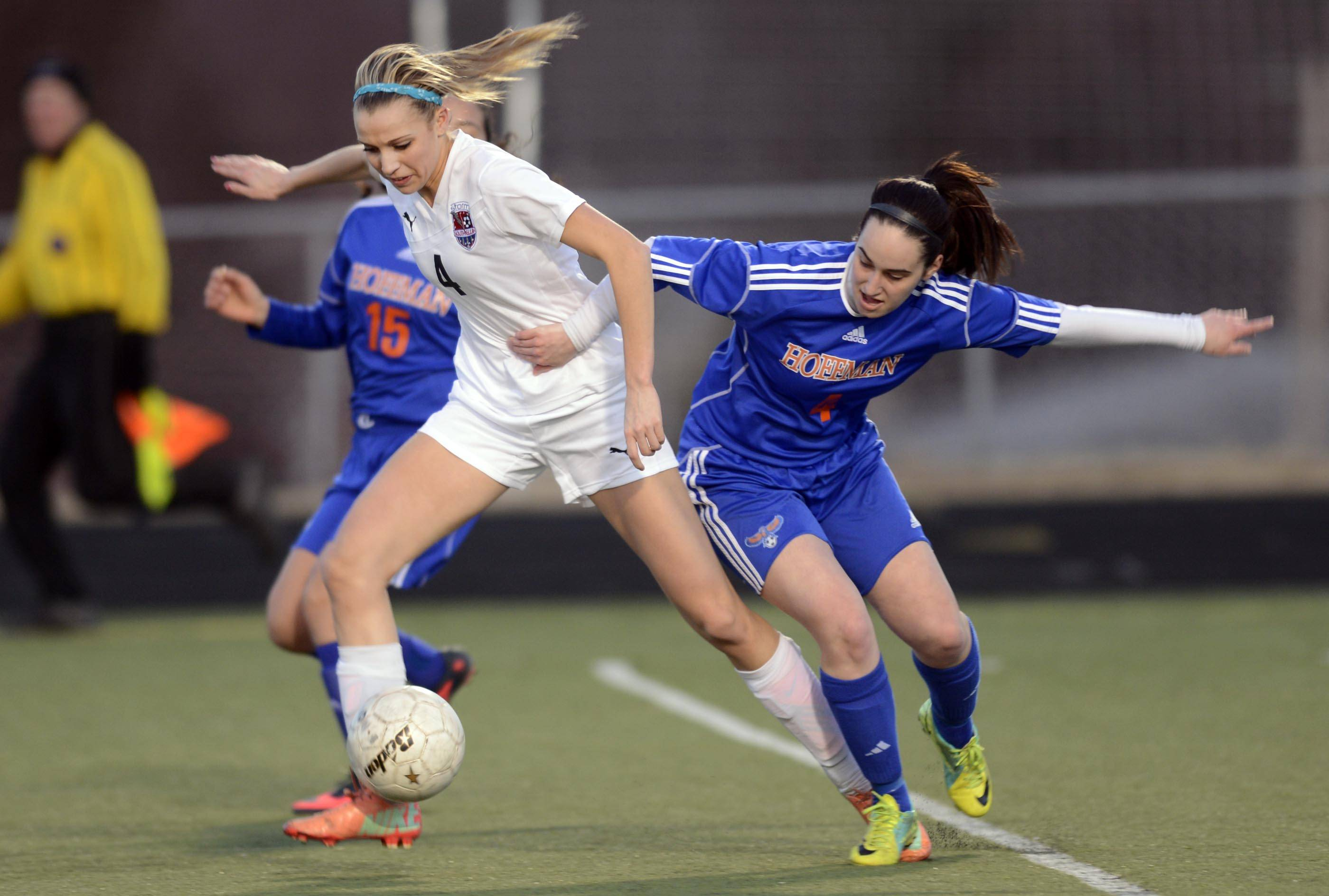 Hoffman Estates' Hannah Brostoff tries to slow down South Elgin's Savanah Uveges Thursday at Millennium Field in Streamwood. Uveges scored on the play.
