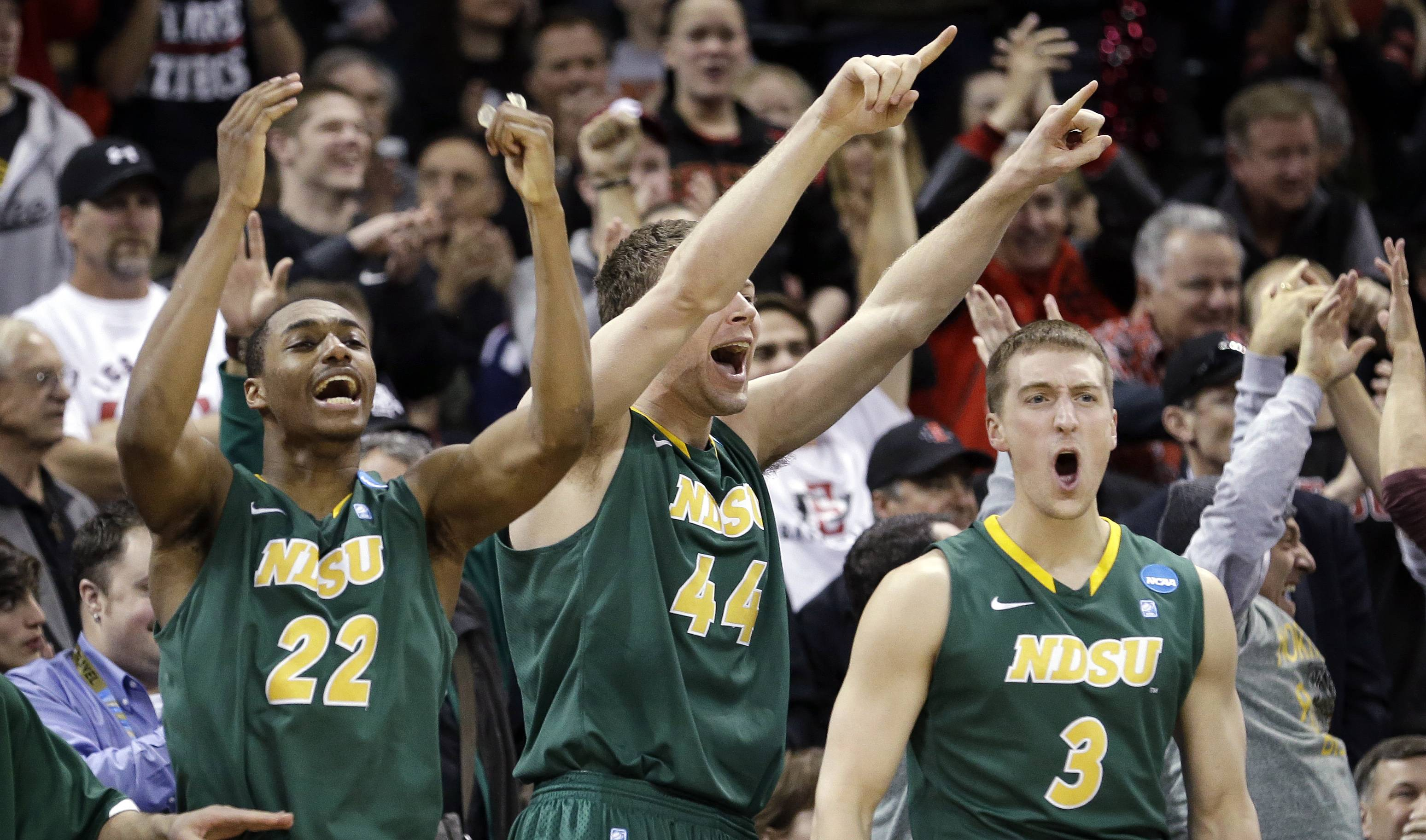 Players on the North Dakota State bench stand and cheer as their team takes the lead against Oklahoma in overtime during a second-round game of the NCAA men's college basketball tournament in Spokane, Wash., Thursday, March 20, 2014. North Dakota State won 80-75 in overtime.