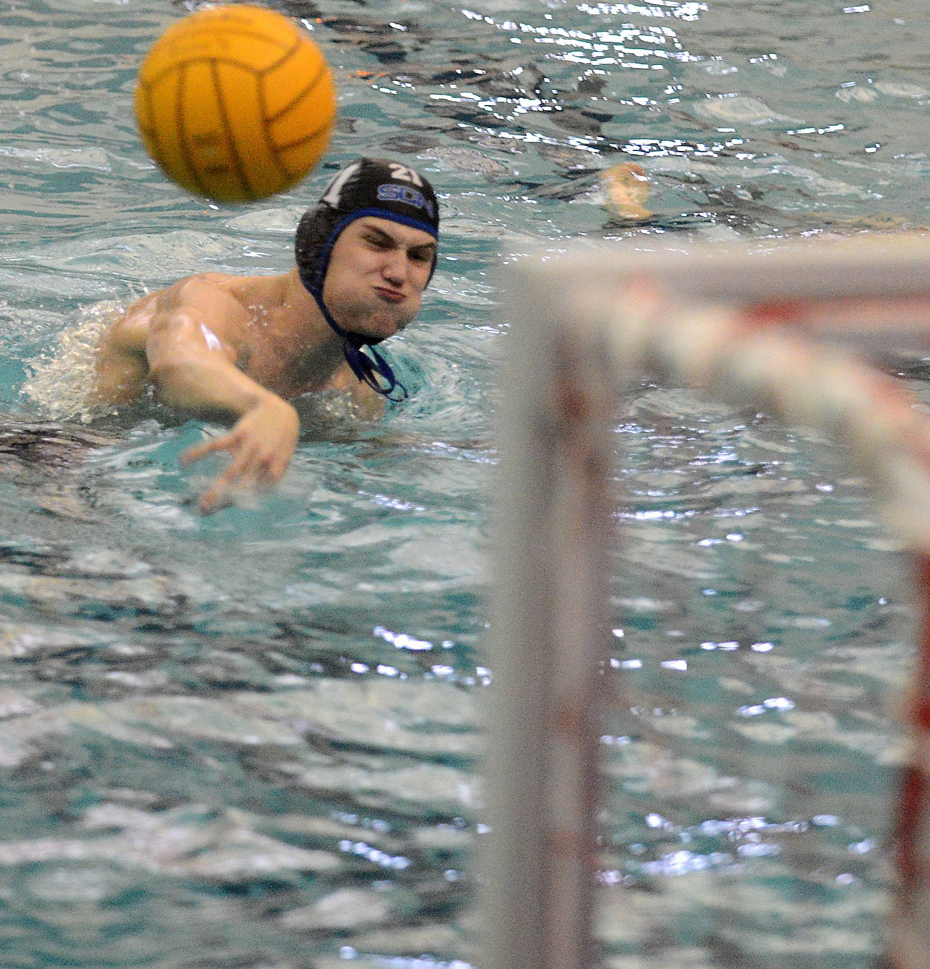 St. Charles North's Nick Traxler scores on a penalty shot against Lockport during water polo action Thursday in St. Charles.