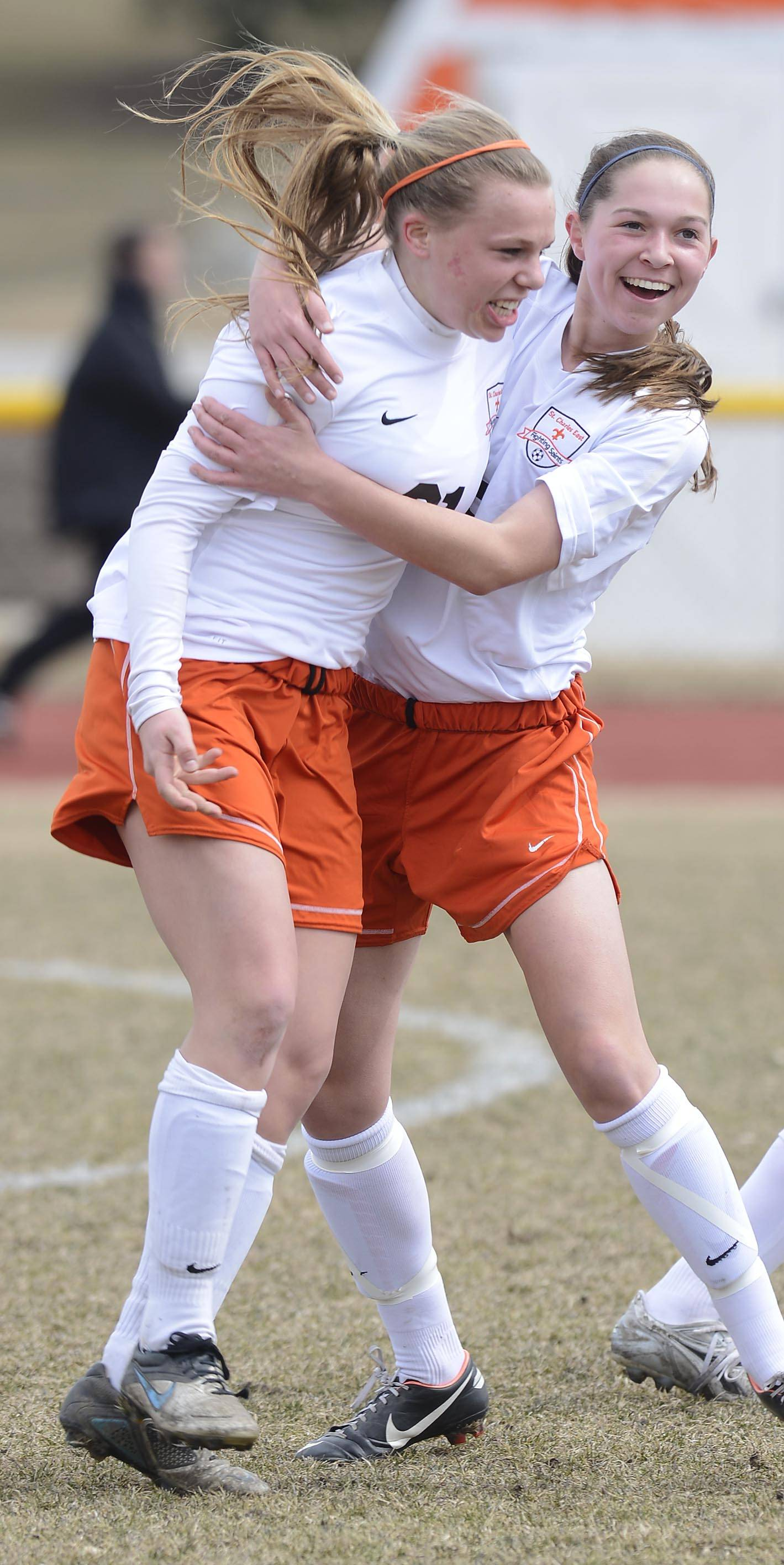 JOE LEWNARD/jlewnard@dailyherald.com ¬ St. Charles East's Amanda Hilton, left, celebrates her goal with teammate Darcy Cunningham, which was the Saint's third goal in just over three minutes of play against Batavia Saturday.