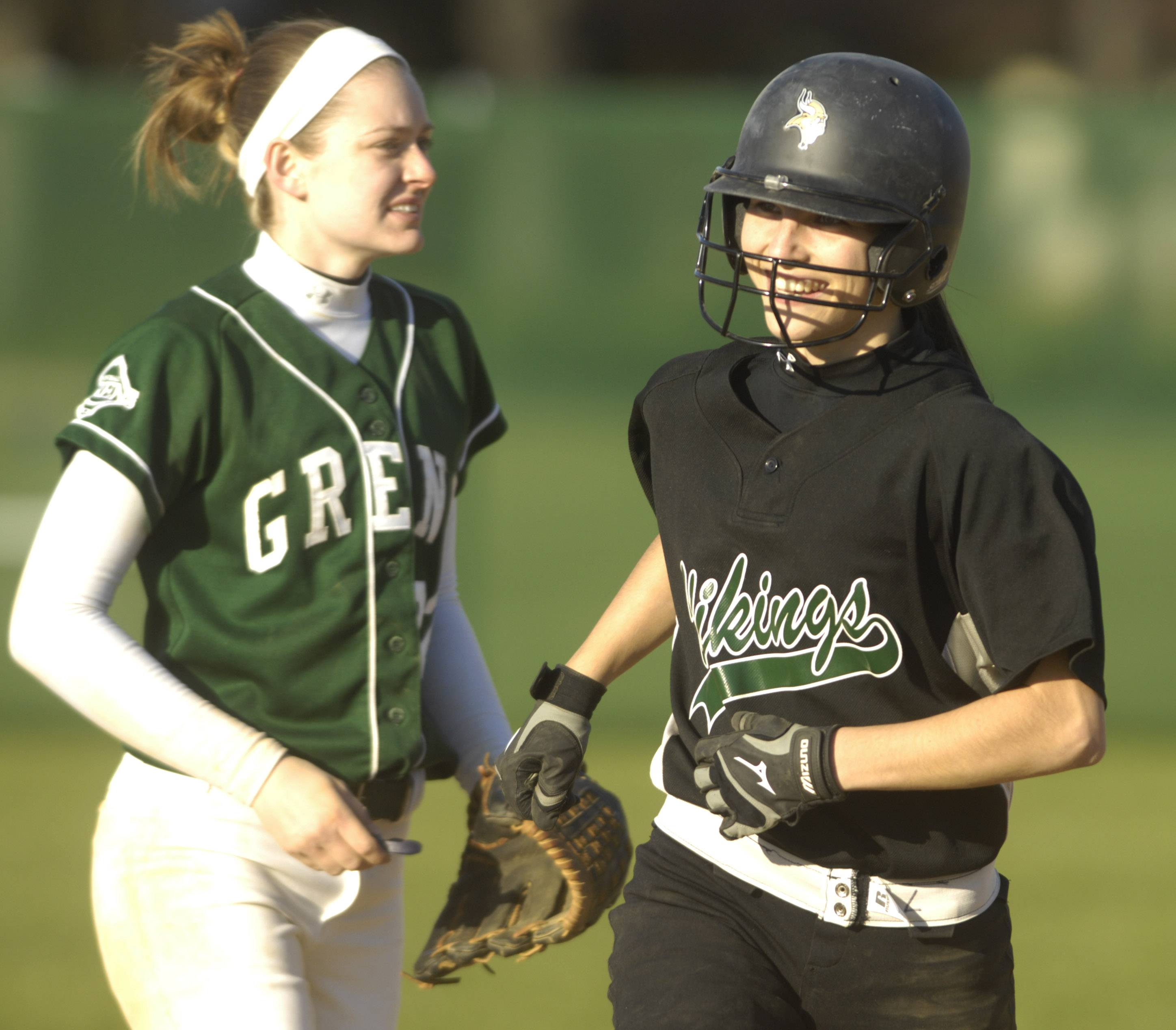 Fremd's Leigh Farina rounds the bases after hitting a home run against Elk Grove.