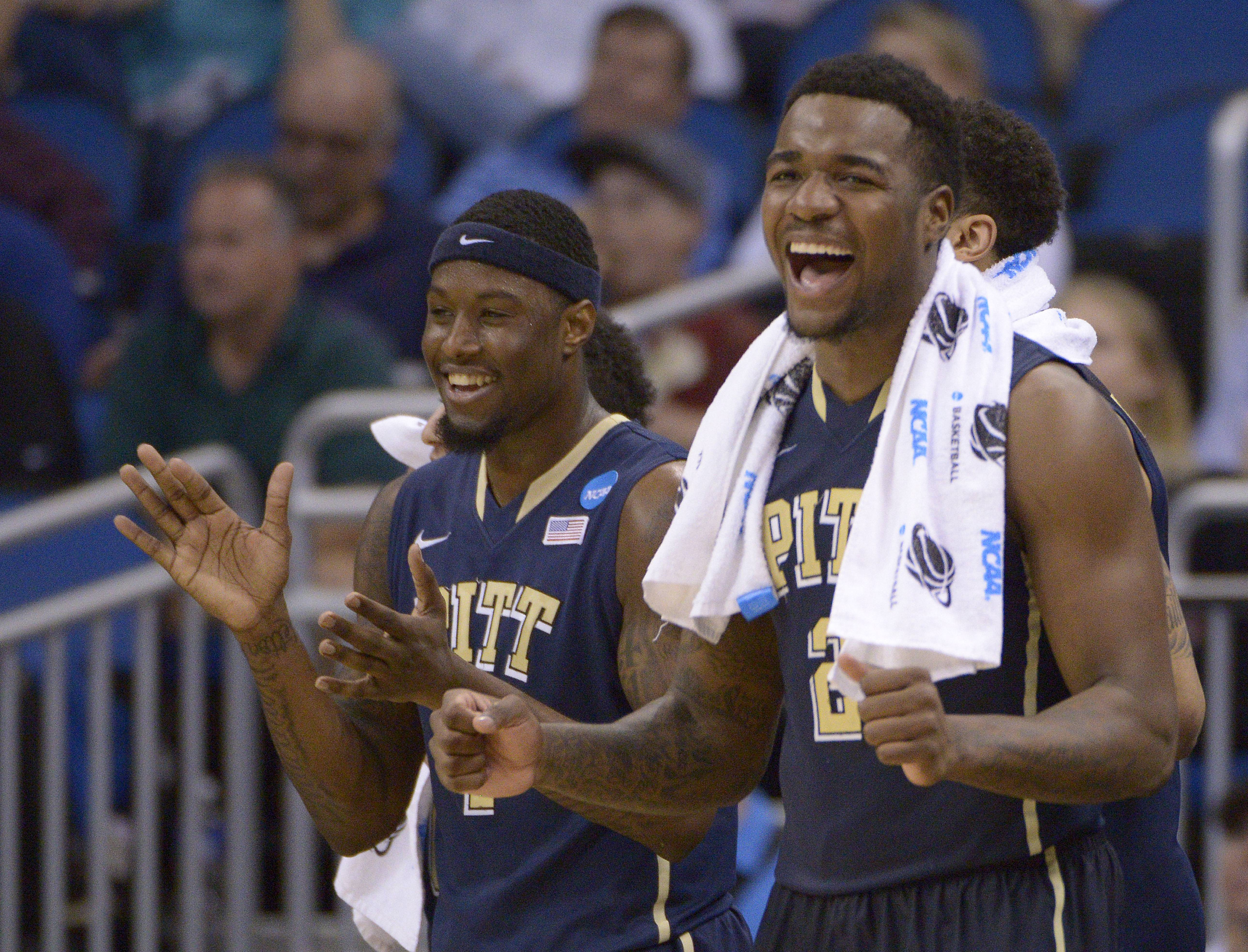 Pittsburgh forwards Jamel Artis (1) and Michael Young (2) celebrate their team's 77-48 victory over Colorado in a second-round game in the NCAA college basketball tournament Thursday, March 20, 2014, in Orlando, Fla.