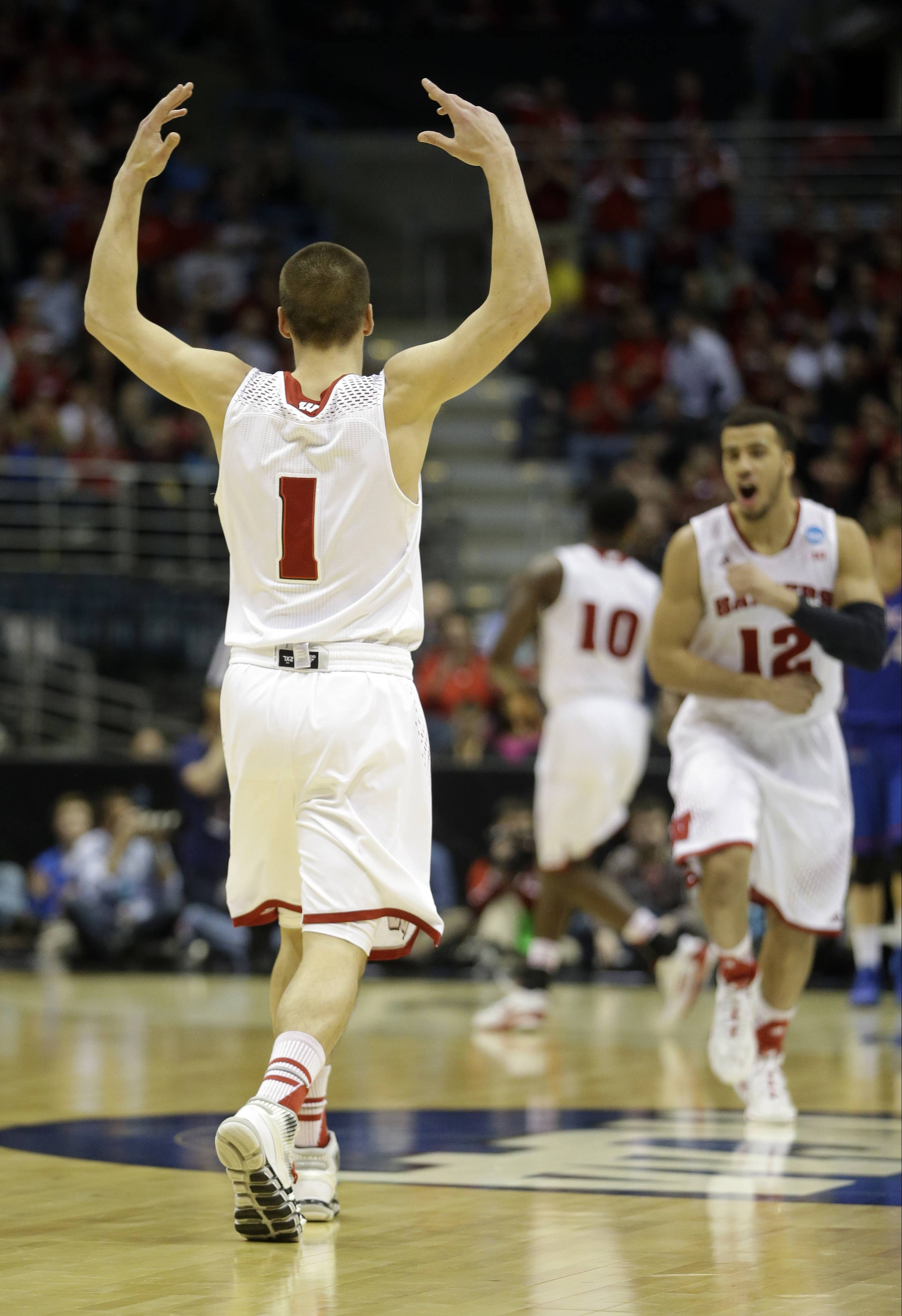 Wisconsin guard Ben Brust (1) celebrates after scoring a three pointer during the second half of a second-round game against the American in the NCAA college basketball tournament Thursday, March 20, 2014, in Milwaukee.