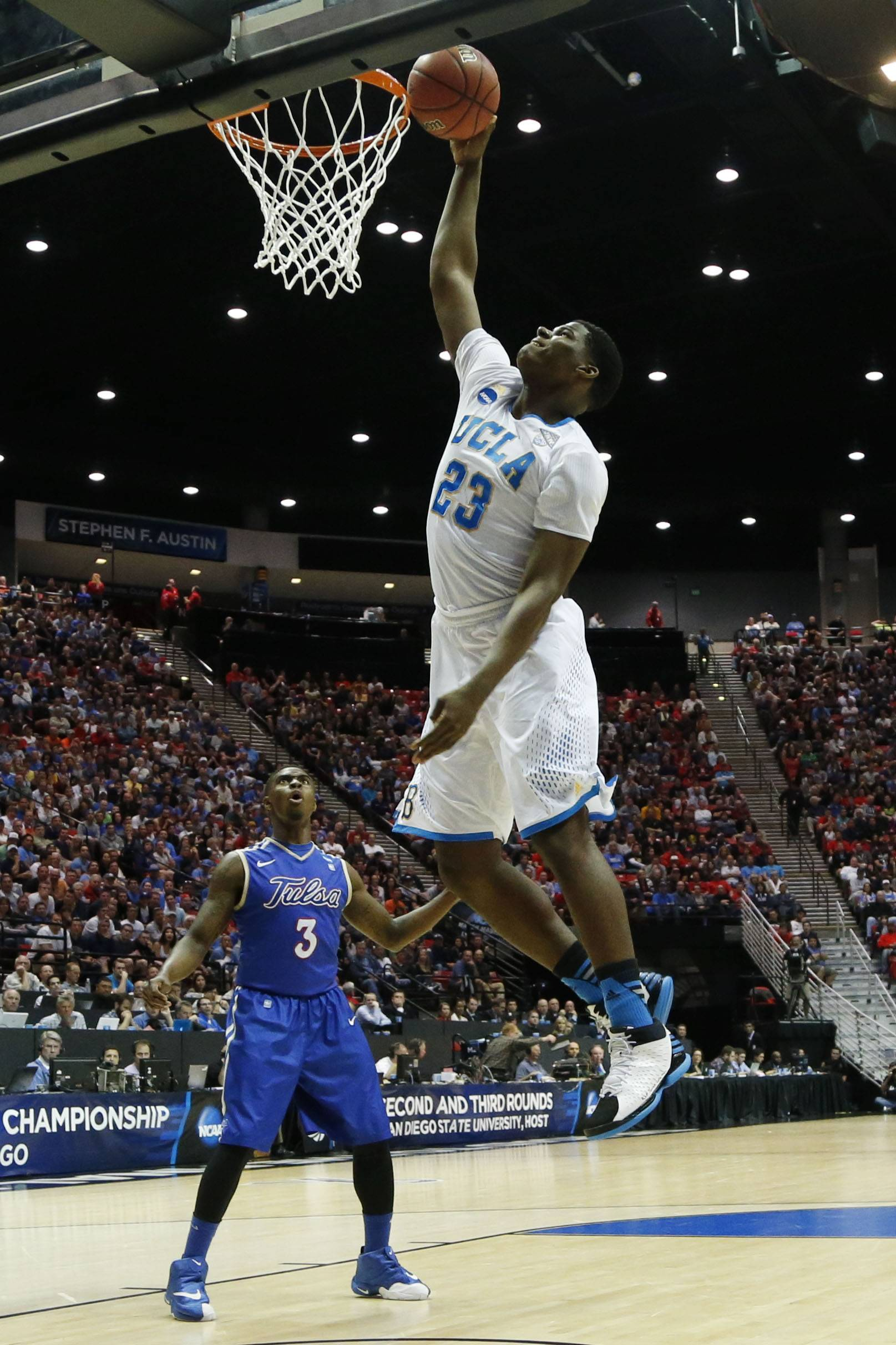 UCLA forward Tony Parker dunks as Tulsa guard Rashad Ray watches during the first half of an NCAA college tournament game Friday in San Diego.