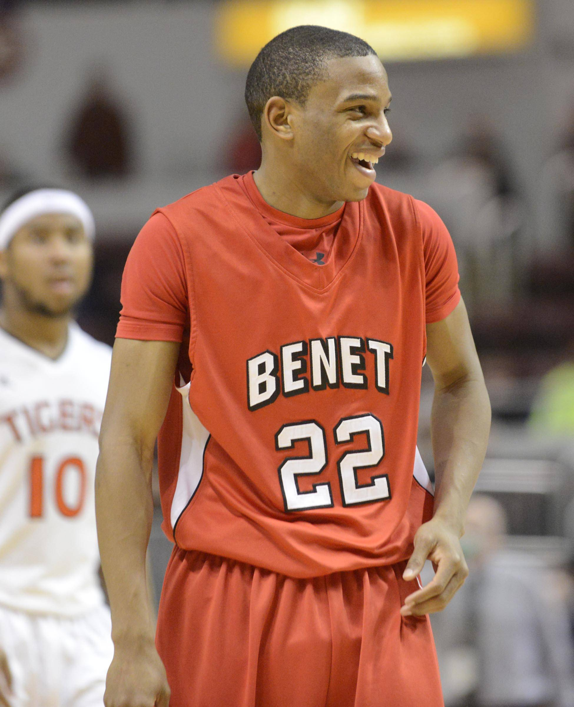 Benet Academy's Josh Yesufu laughs at his teammates on the bench as he comes to the foul line late in the win against Edwardsville in the Class 4A state semifinal at Carver Arena in Peoria Friday.
