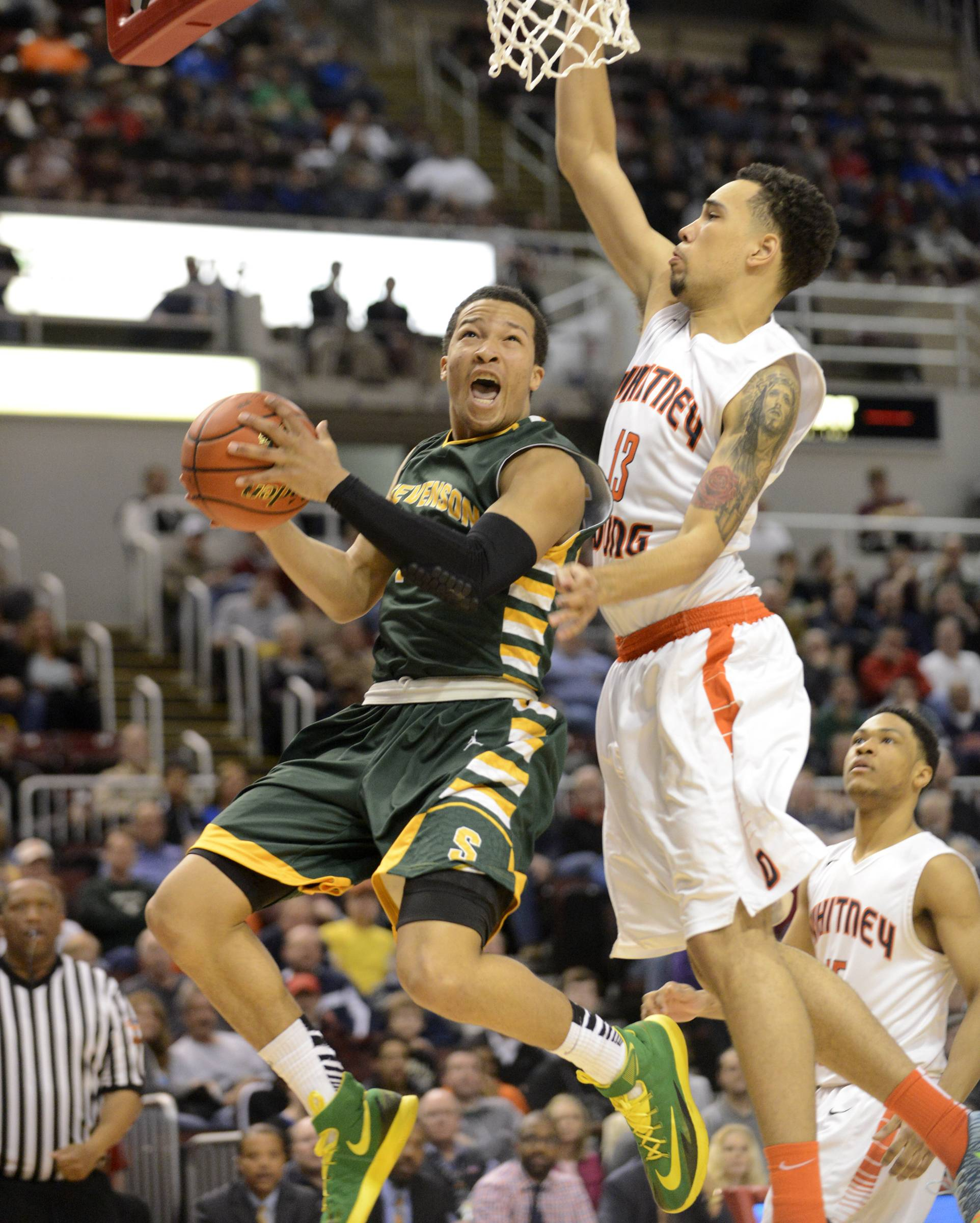 Stevenson's Jalen Brunson scores the first points of the game against Whitney Young in the Class 4A state semifinals at Carver Arena in Peoria on Friday. The Patriots junior guard set an all-time state tournament record with 56 points in a 75-68 loss.