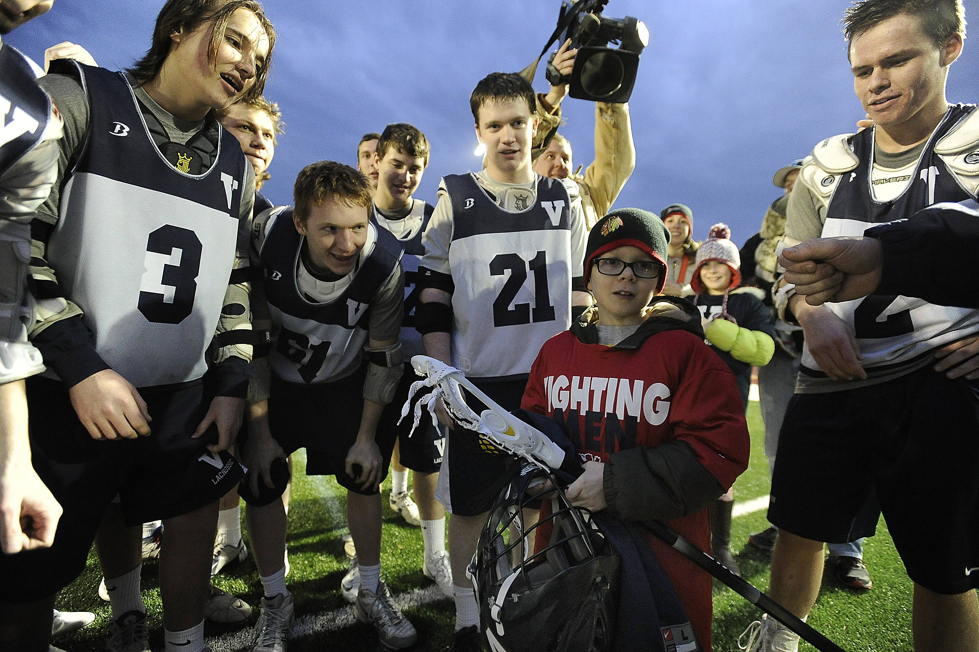 The St. Viator boys lacrosse team honored 8-year-old Dylan Full, who has been battling cancer, as part of Friday's game against Marian Catholic at Forest View Educational Center. The team presented Full with a helmet, stick and jersey in addition to an abundance of love.