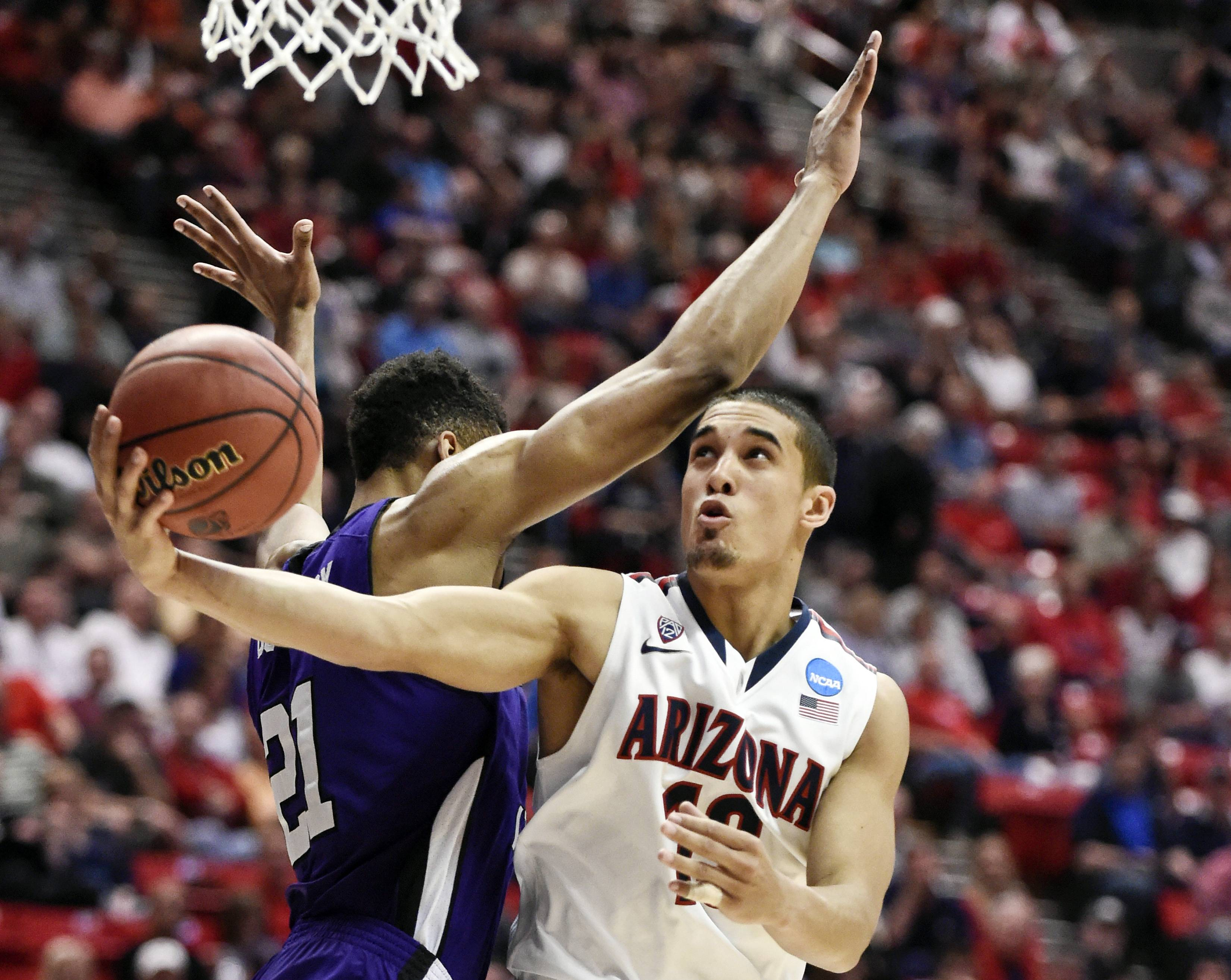 Arizona overpowers Weber State 68-59 in West
