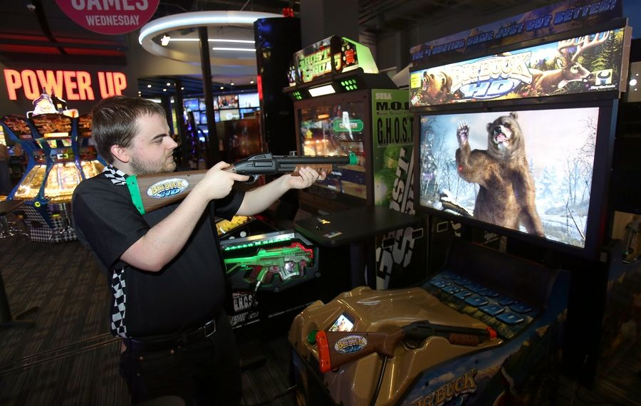 Game technician Steve Stayman tests a shooting video game as the Dave & Buster's at Westfield Hawthorn mall in Vernon Hills prepares to open Wednesday.
