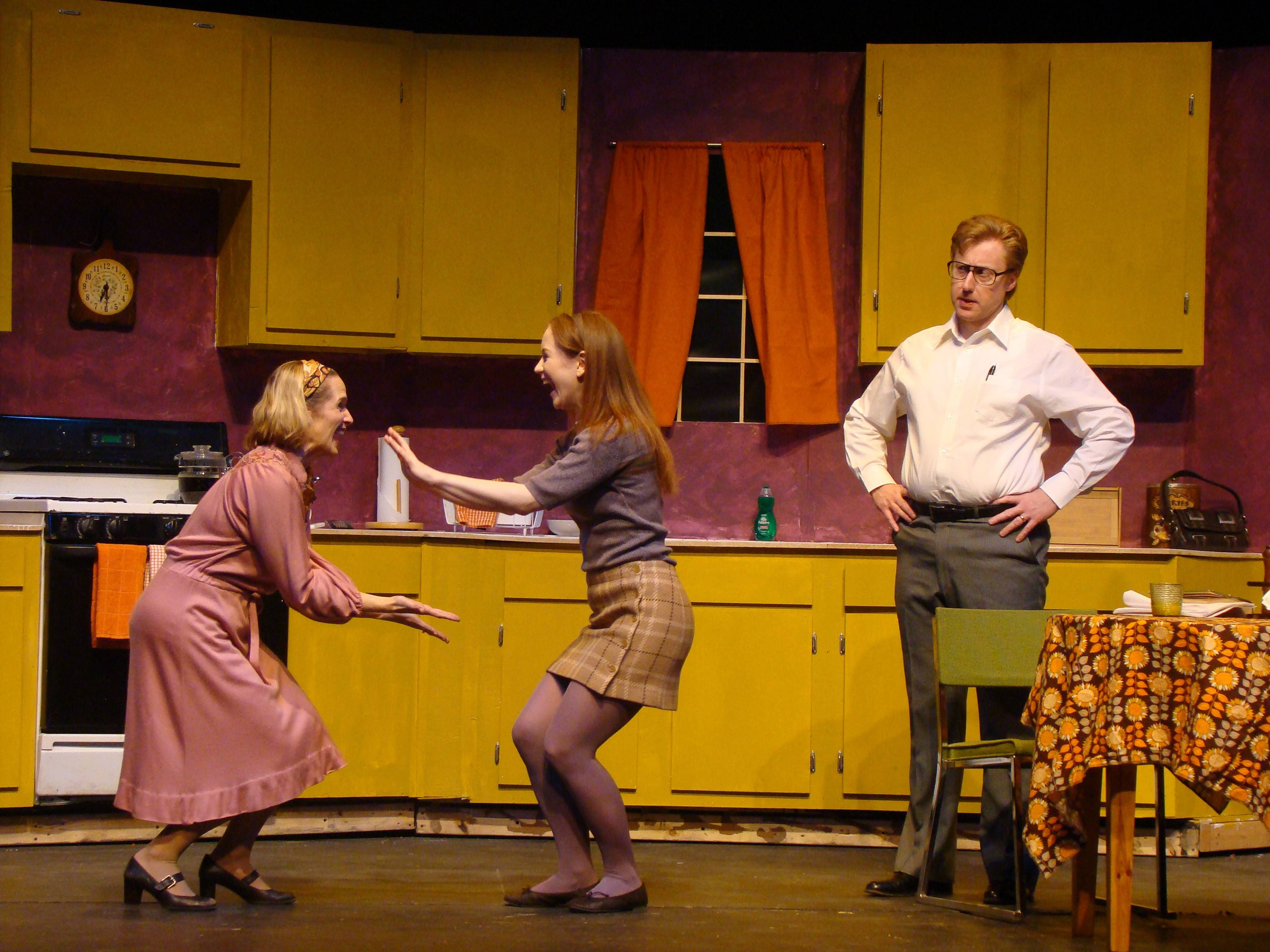 "Julie Partyka, left, Katie Hunter and Andrew Pond star in ""Half and Half,"" a drama about the changing role of families and marriage, at the Metropolis Performing Arts Centre in Arlington Heights."