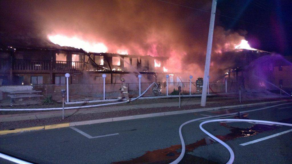 Firefighters work to put out a fire at  Mariner's Cove Inn in Point Pleasant Beach, N.J. early Friday.