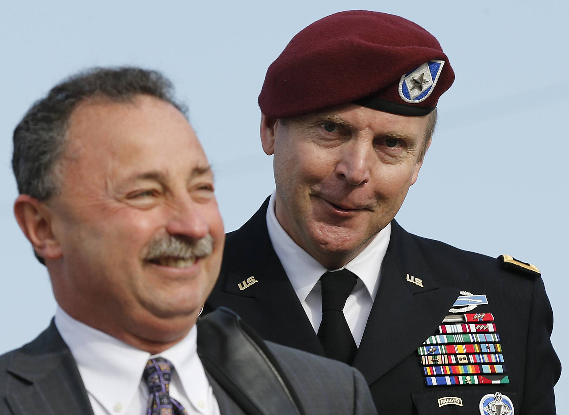 Brig. Gen. Jeffrey Sinclair, right, who admitted to inappropriate relationships with three subordinates, was spared any time behind bars Thursday and sentenced to a reprimand and a $20,000 fine.