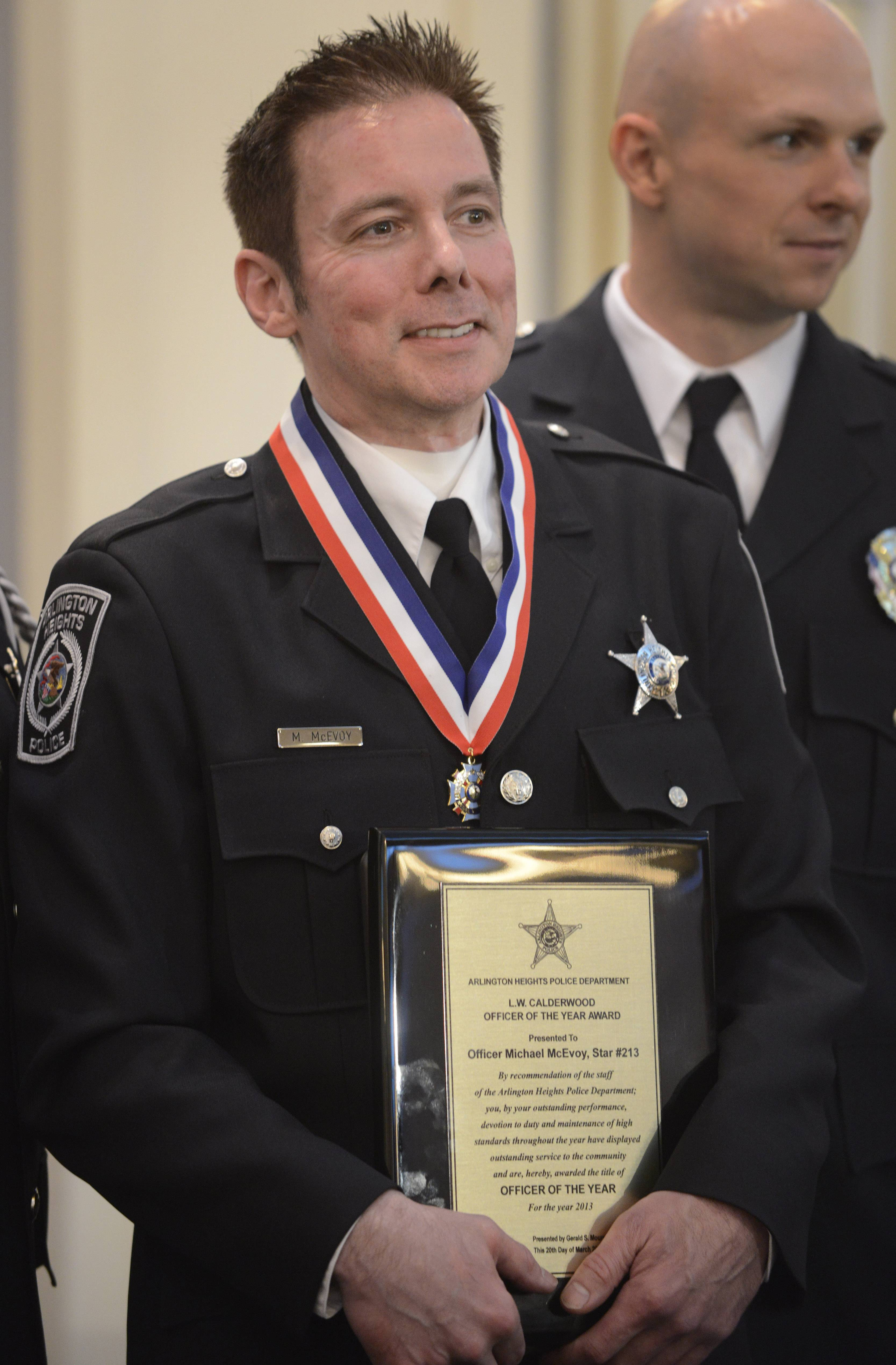 Arlington Heights police officer Michael McEvoy, who was shot while responding to a call last December, holds the L.W. Calderwood Officer of the Year award at a luncheon Thursday at the European Crystal banquet hall.