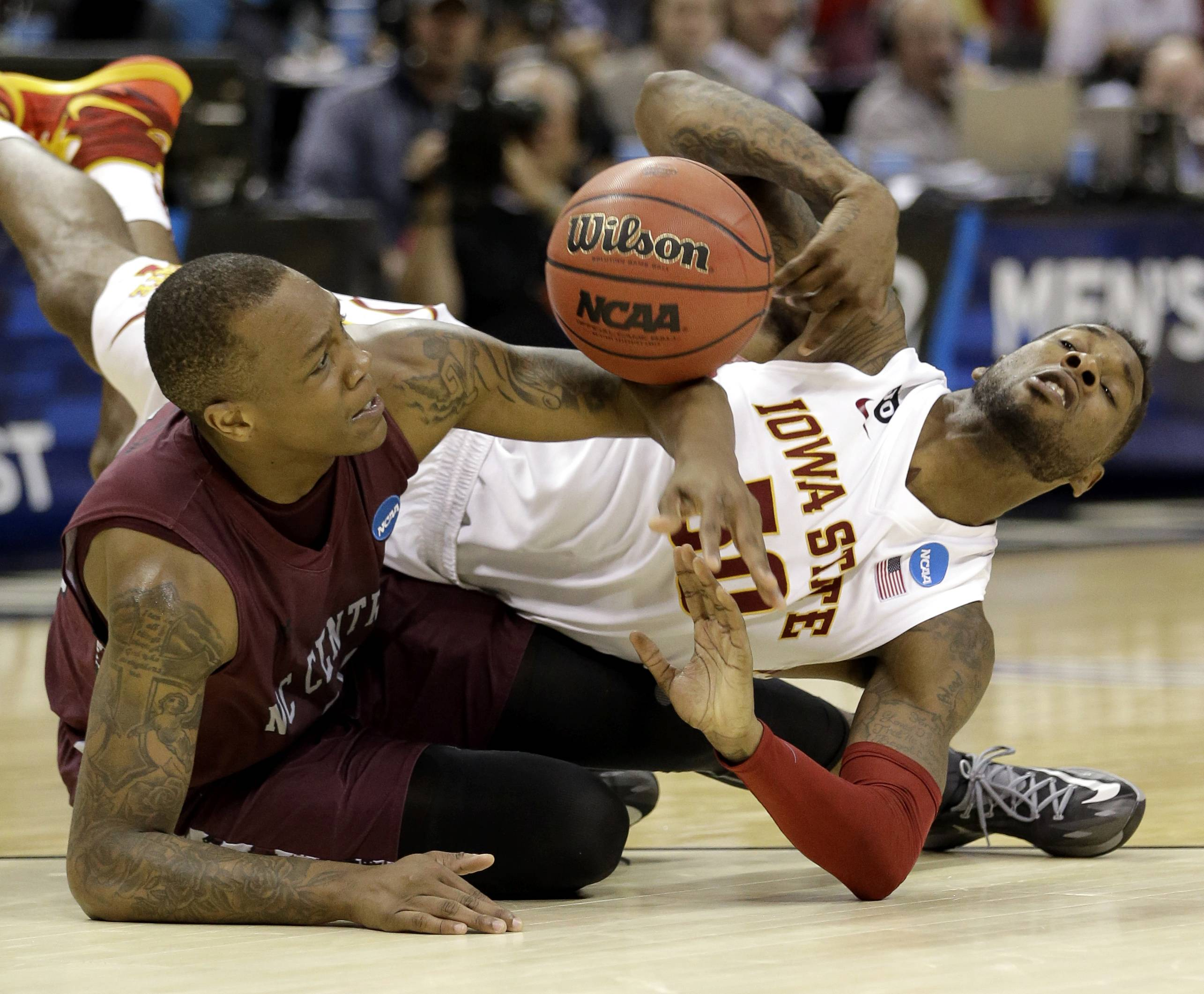 Iowa State's DeAndre Kane battles North Carolina Central's Alfonzo Houston for a loose ball during an NCAA tournament game Friday, in San Antonio. Iowa State won 93-75.