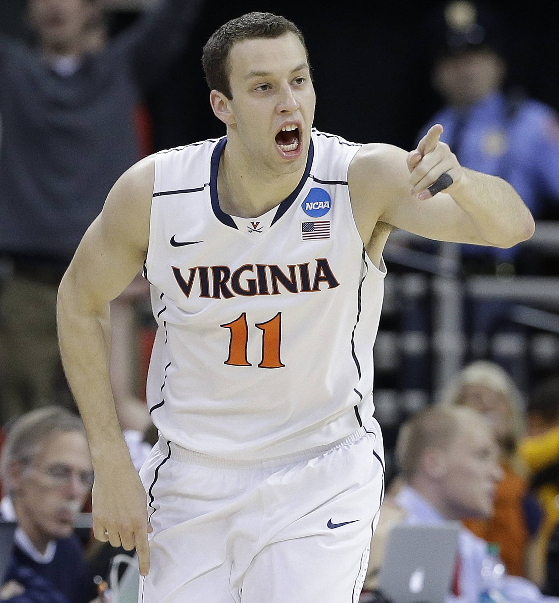 Virginia forward Evan Nolte celebrates a basket against Coastal Carolina during the second half of an NCAA tournament game Friday in Raleigh.