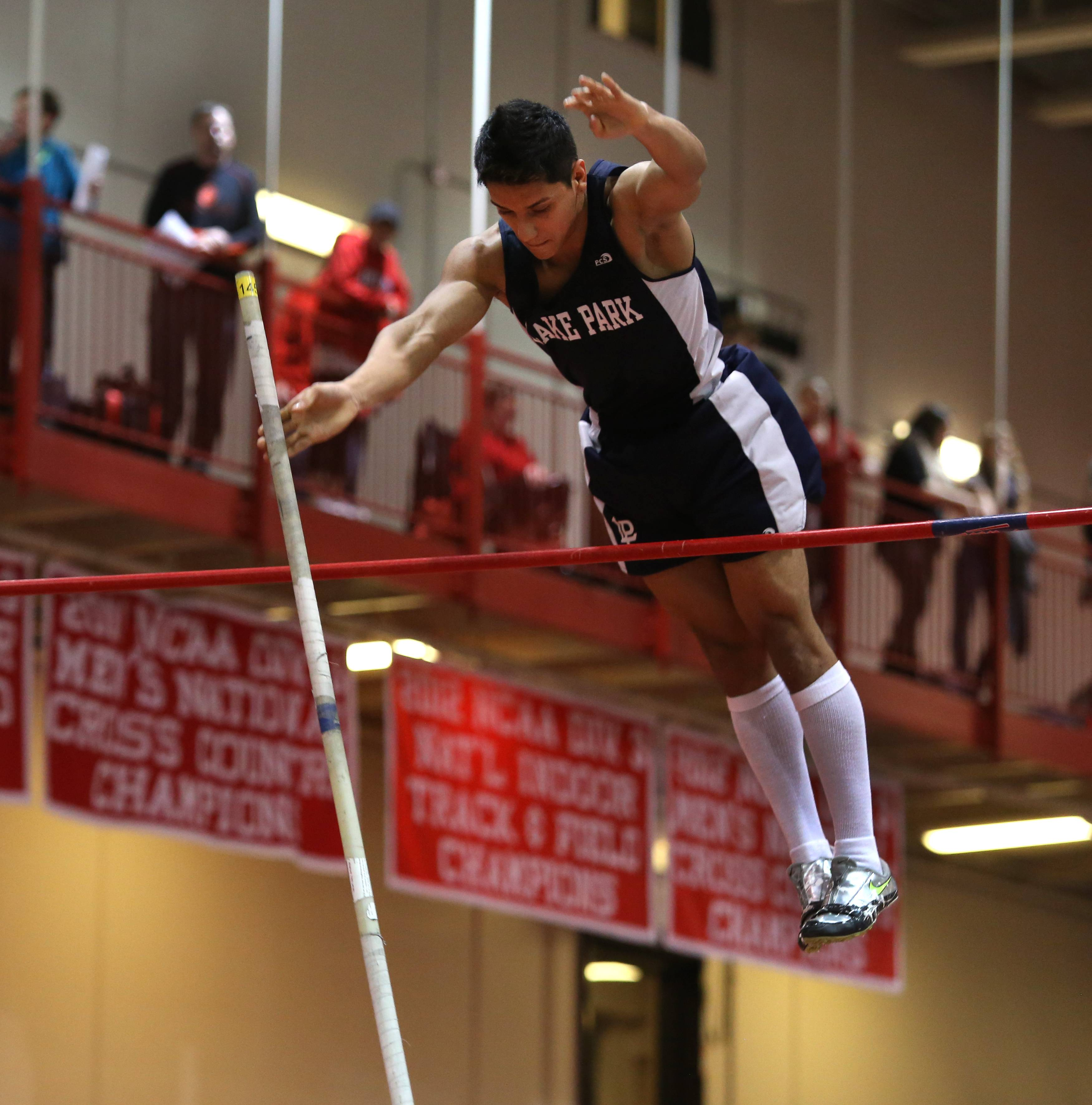 Lake Park's Felix Gates competes in the pole vault during the DuPage Valley Conference Boys' Indoor Track & Field Invitational at North Central College.