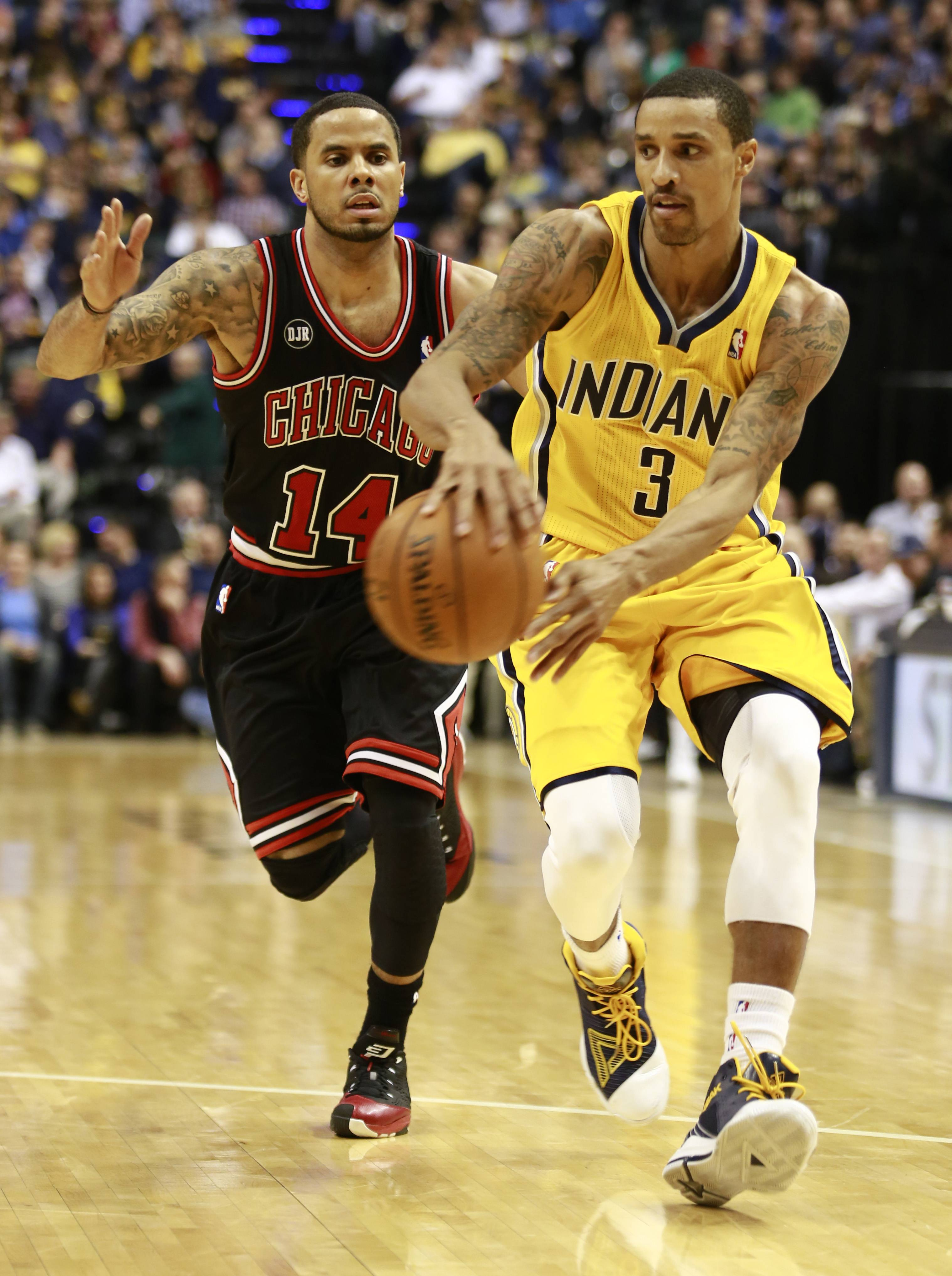 Indiana Pacers guard George Hill (3) passes the basketball while trailed by Chicago Bulls guard D.J. Augustin in the second half of an NBA basketball game in Indianapolis, Friday, March 21, 2014. The Pacers won 91-79.