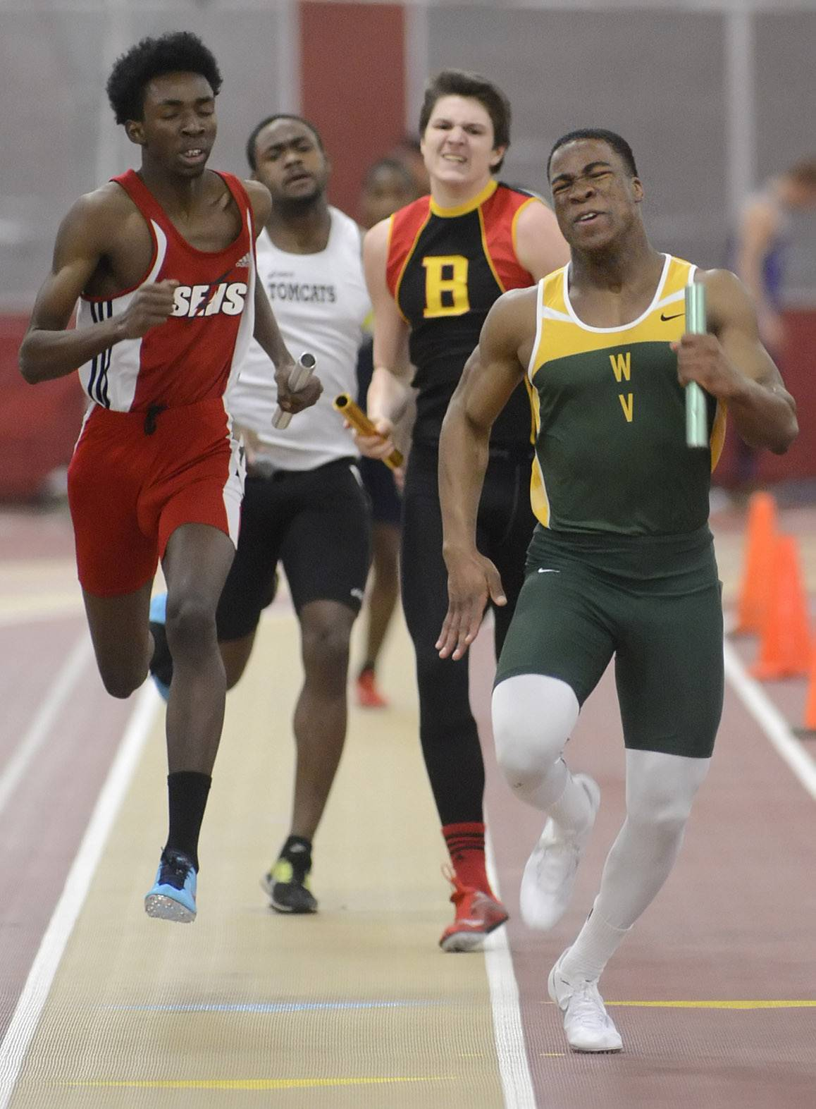 Waubonsie Valley's Justin Rich gives it his all as he approaches the finish line to take first place for his team in the 4 x 200 meter relay at the Upstate Eight Conference in Batavia on Friday.