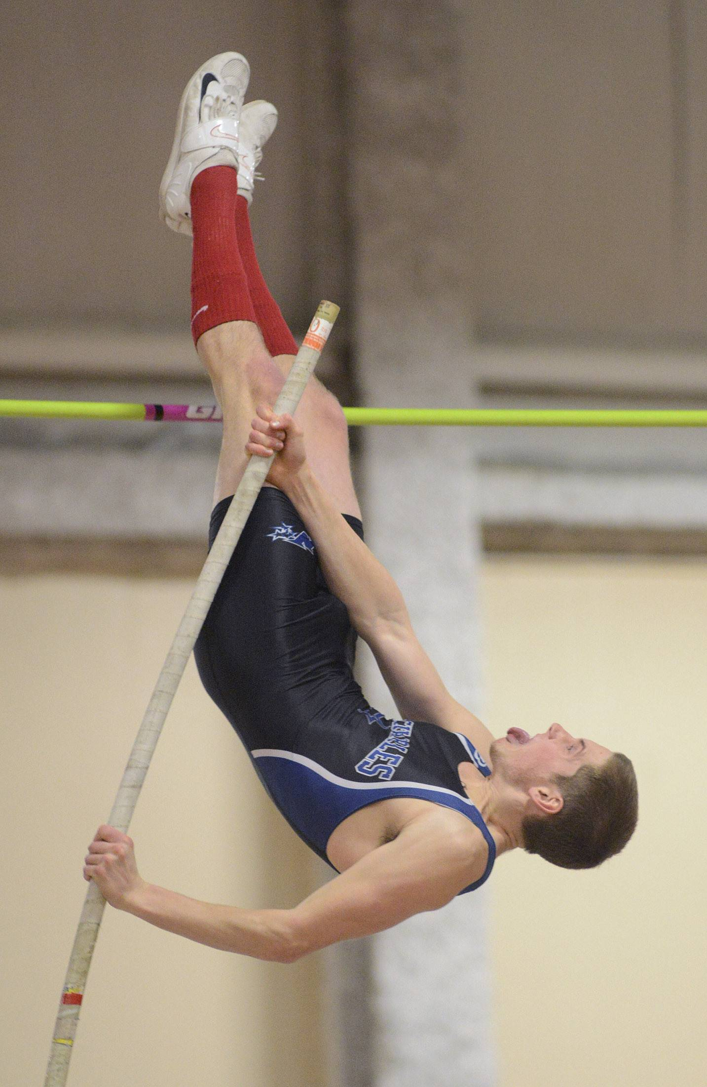 St. Charles North's Drew Egger in the pole vault at the Upstate Eight Conference in Batavia on Friday.