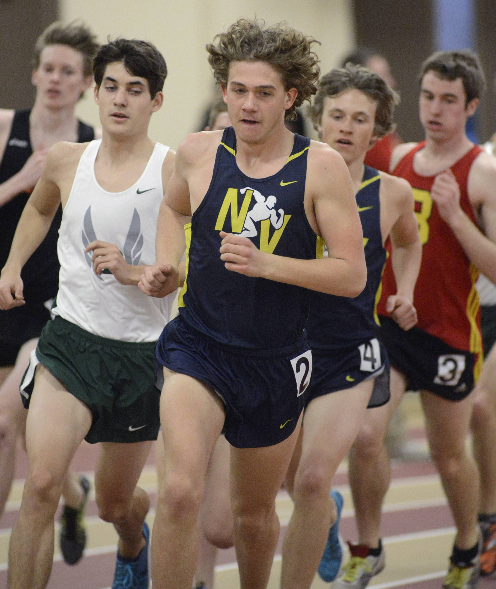 Laura Stoecker/lstoecker@dailyherald.comNeuqua Valley's Nick Bushelle leads the 3200 meter run with Bartlett's Dan Cotton trailing him (left) the whole race at the Upstate Eight Conference in Batavia on Friday, March 21.