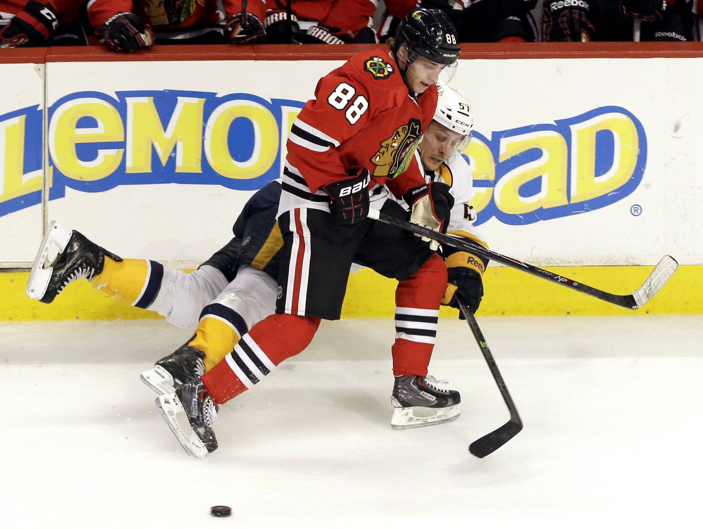 The Blackhawks' Patrick Kane and the Predators' Gabriel Bourque battle for the puck March 14 during a game at the United Center.