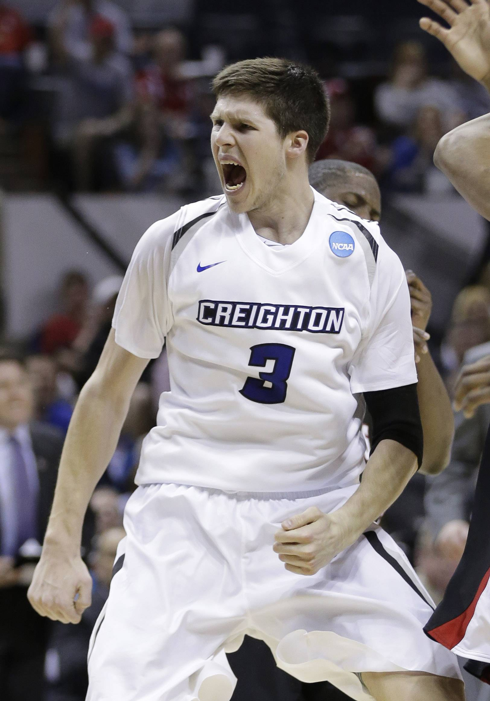 Creighton's Doug McDermott (3) celebrates a score against Louisiana-Lafayette during the second half of a second-round game in the NCAA college basketball tournament Friday, March 21, 2014, in San Antonio. Creighton won 76-66.