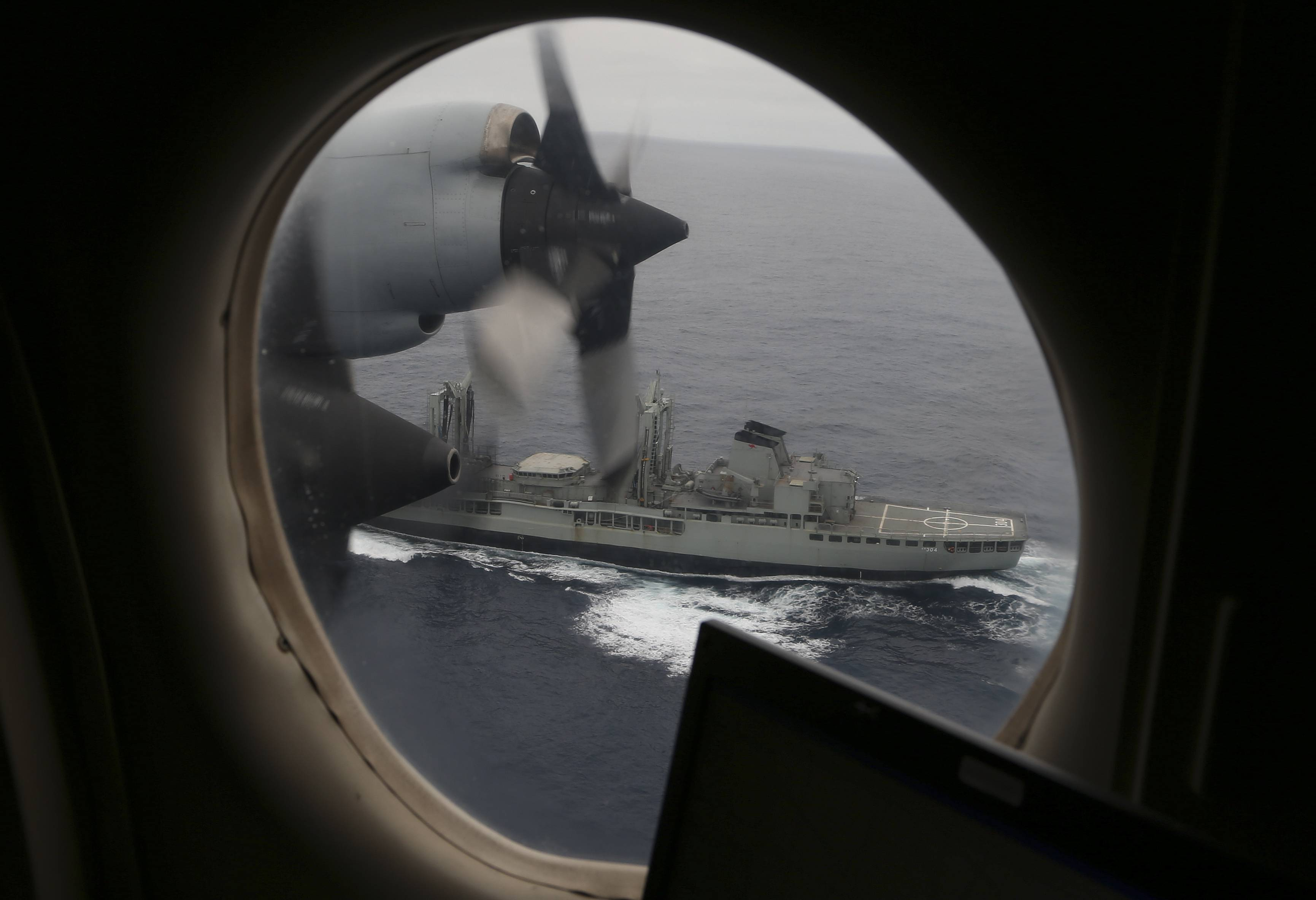 Australian Navy's HMAS Success, seen from the widow of a Royal Australian Air Force AP-3C Orion, searches Saturday for missing Malaysia Airlines flight MH370 in the southern Indian Ocean, Australia.