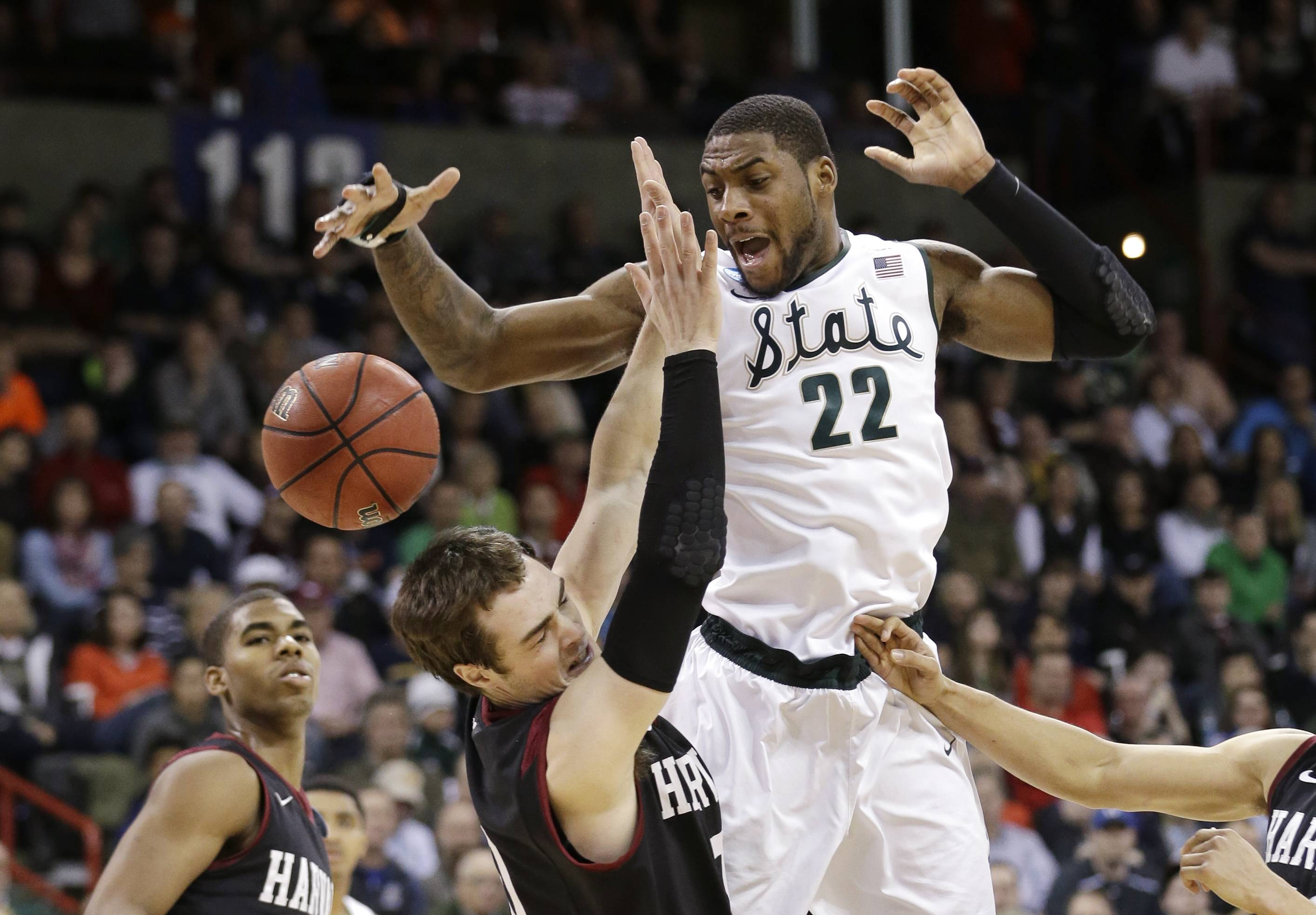Michigan State's Branden Dawson (22) and Harvard's Laurent Rivard go for a loose ball during a third round game of the NCAA men's college basketball tournament Saturday in Spokane, Wash. Michigan State won 80-73, thanks in part to Dawson's career-high 26 points.