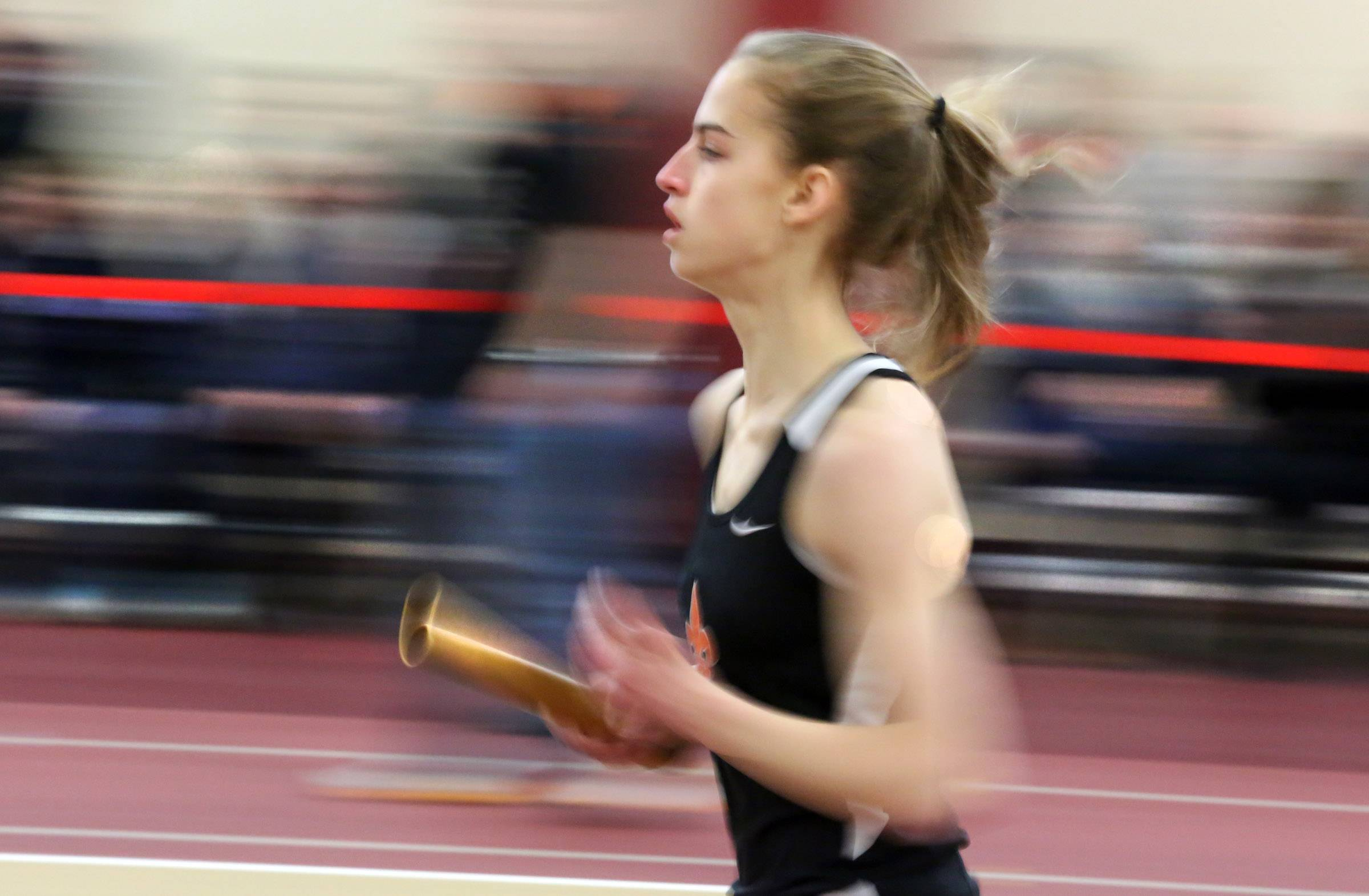 St. Charles East Hannah Ewald runs the first leg of 4 x 800 meter relay final in an Upstate Eight Conference indoor track meet on Saturday at Batavia.