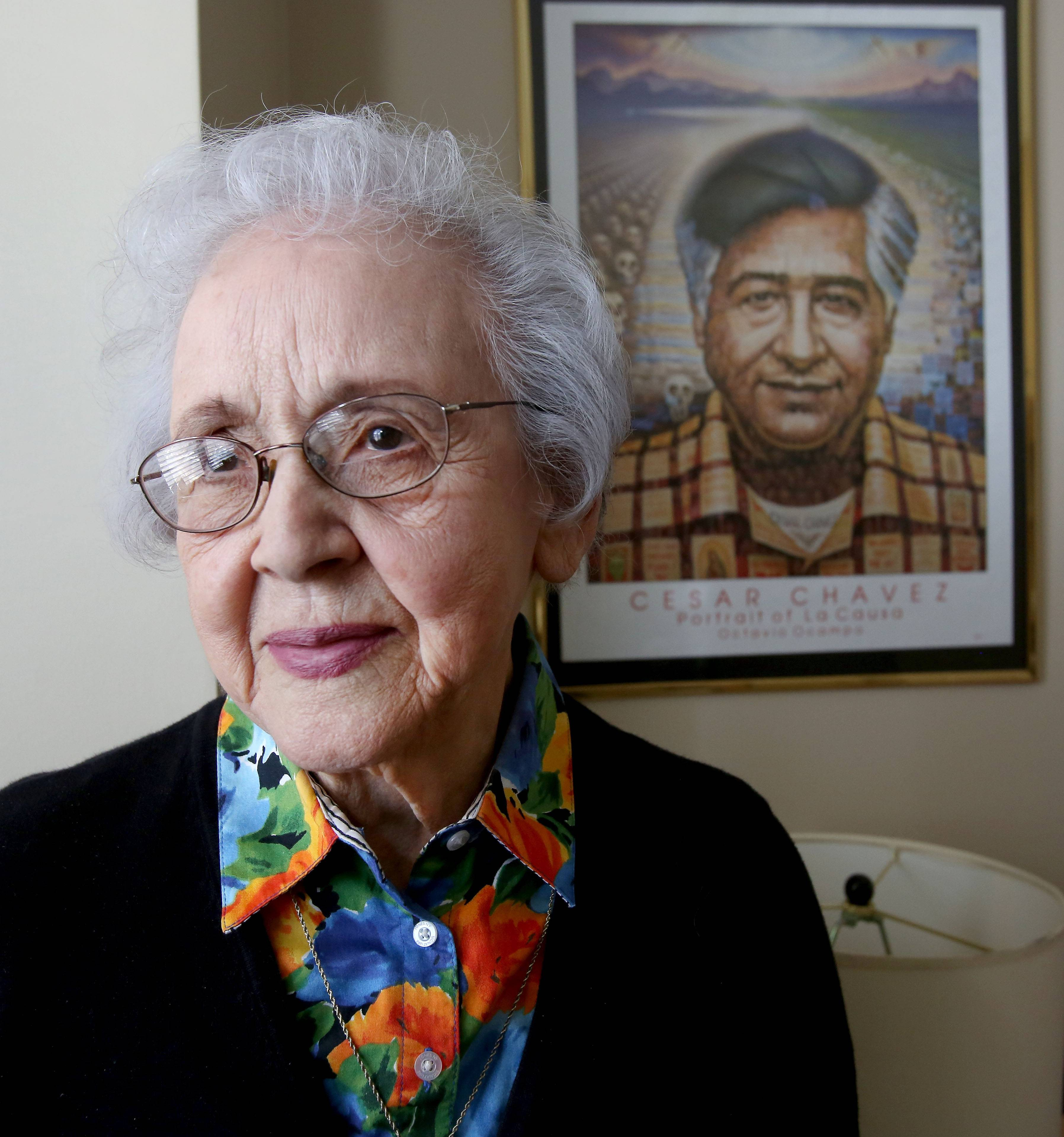 Olgha Sandman, a friend and associate of migrant worker, labor leader and civil rights advocate Cesar Chavez, has a portrait of him hanging in her Downers Grove apartment.