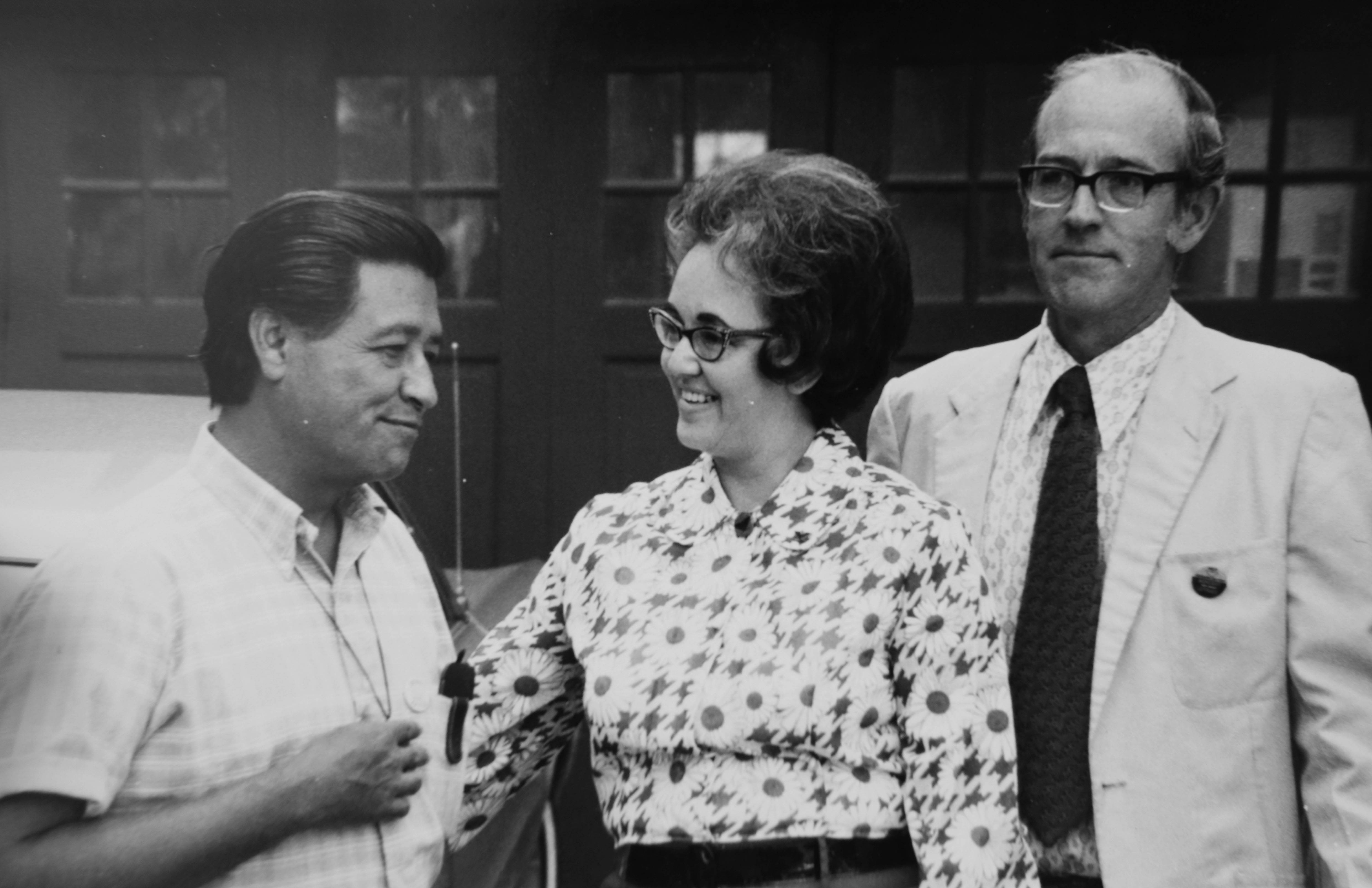 Olgha Sandman with her husband, the Rev. Dr. J. Robert Sandman, right, and migrant worker advocate Cesar Chavez, left, in a photo from 1972.