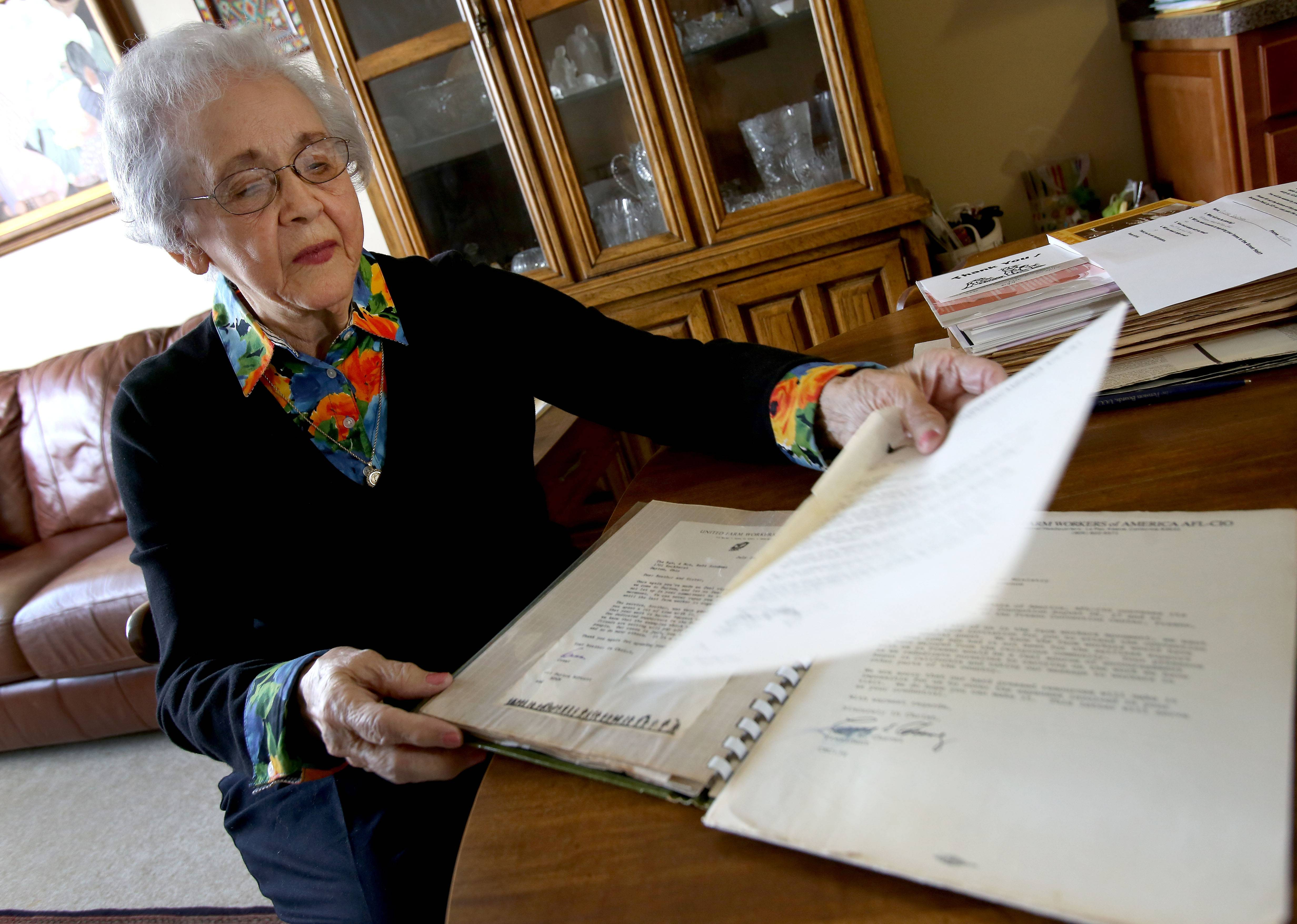 Olgha Sandman looks through letters written to her by migrant worker advocate Cesar Chavez.