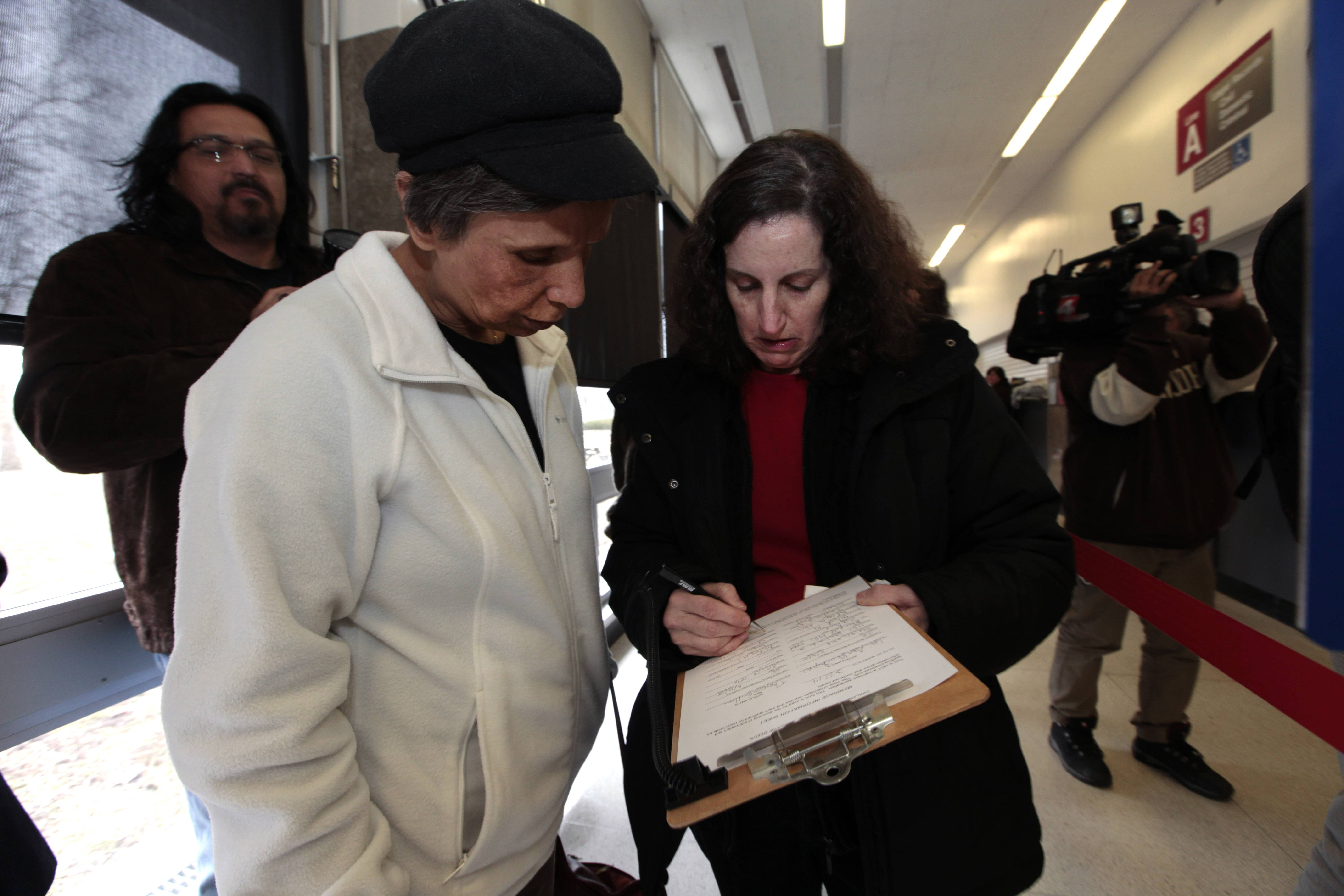 Theresa Guillen, left, and Lori Klein Shapiro, fill out information for a marriage license Saturday at the Oakland County Clerks office in Pontiac, Mich.