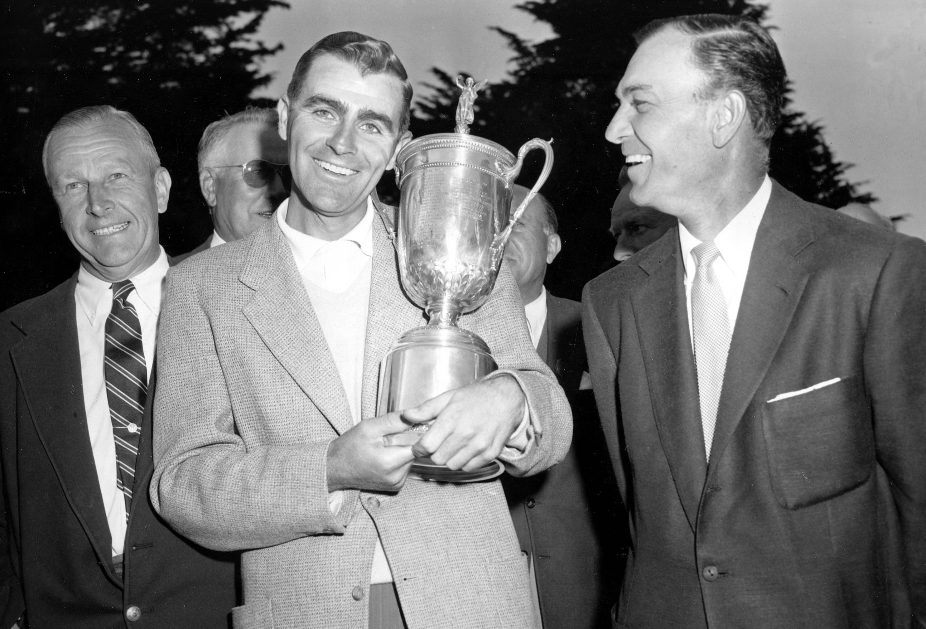 Jack Fleck, of Davenport, Iowa, poses with his championship trophy after beating Ben Hogan, right, by three strokes in an 18-hole playoff in the U.S. Open golf tournament at the Olympic Club, Lake Course, in San Francisco.
