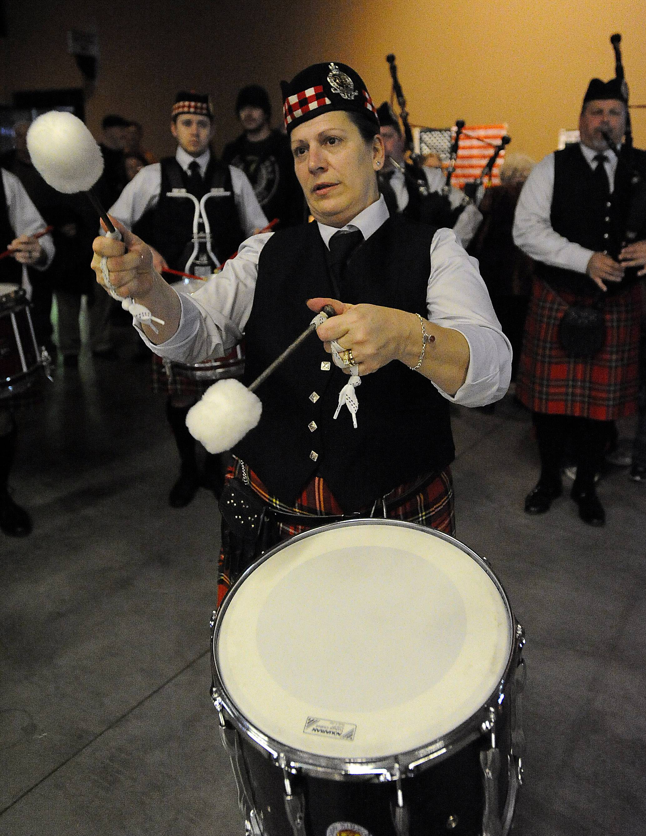 Mary Bjorkman of Hanover Park plays with the Chicago Highland Pipes and Drums at the third annual Northwest Celtic Fest on Saturday at the Sears Centre in Hoffman Estates.