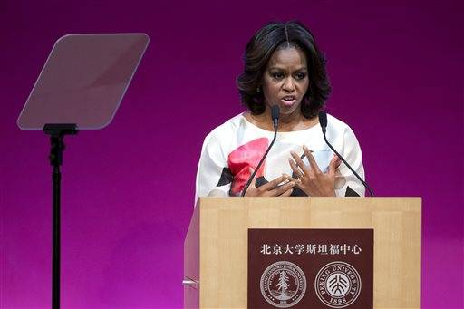 U.S. first lady Michelle Obama delivers a speech at Stanford Center in Peking University in Beijing, China, Saturday, March 22, 2014.